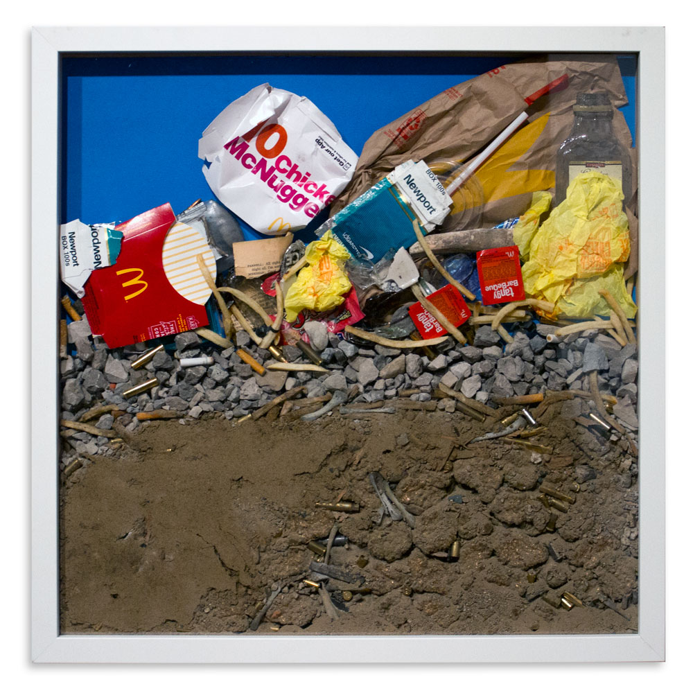 """Gold Rush 24"""" x 24"""" Chicken McNuggets, Dirt, Found Objects, Shell Casings $750"""