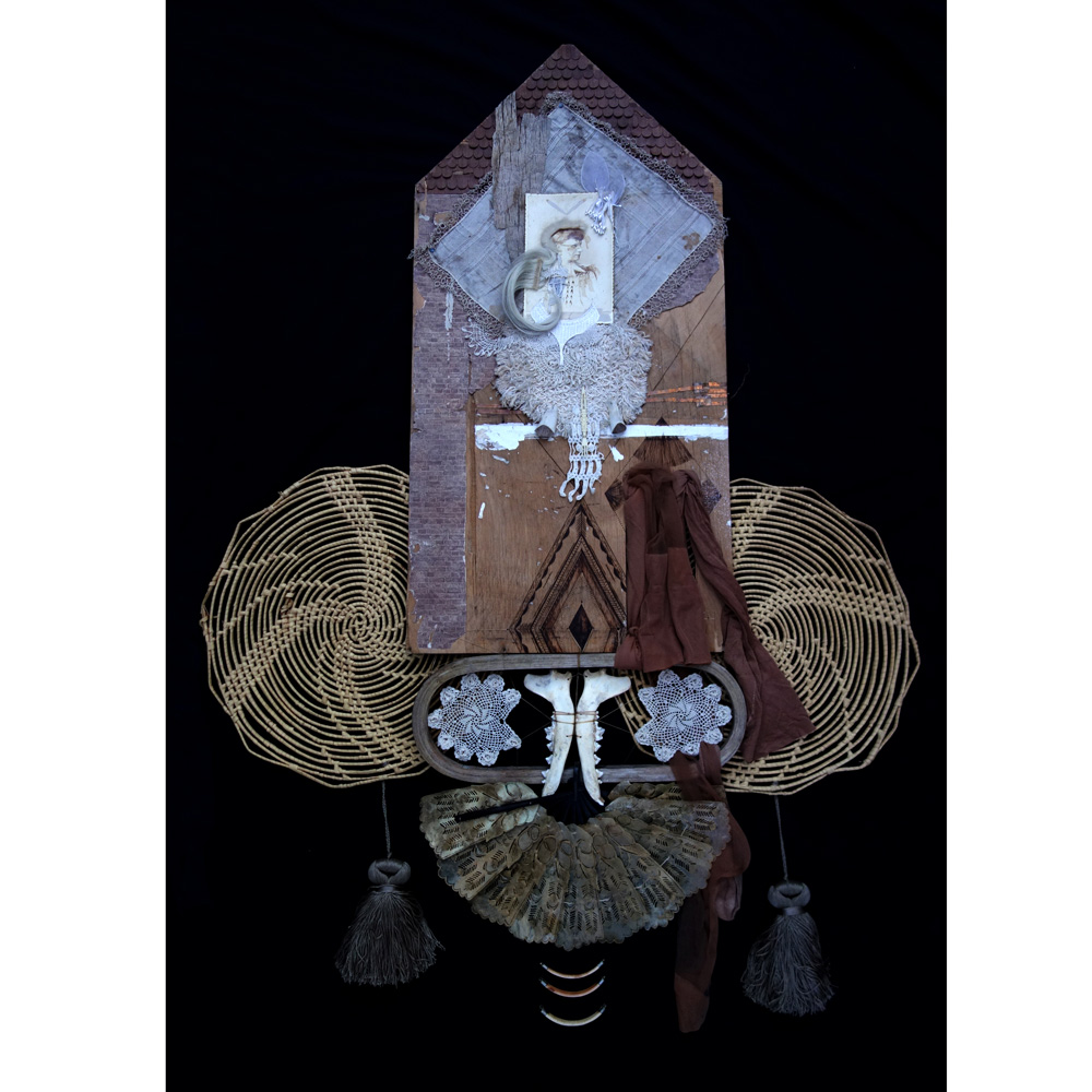 """Breath Beneath Rubble  32"""" x 48"""" Found Wood Panel, Burning, Copper, Hair, Lace and Textiles, Jaw and other antique Bones, Tassels, Horn, Rawhide Fan, Stockings, Mixed Media on Antique Parlor Portrait $3,500"""