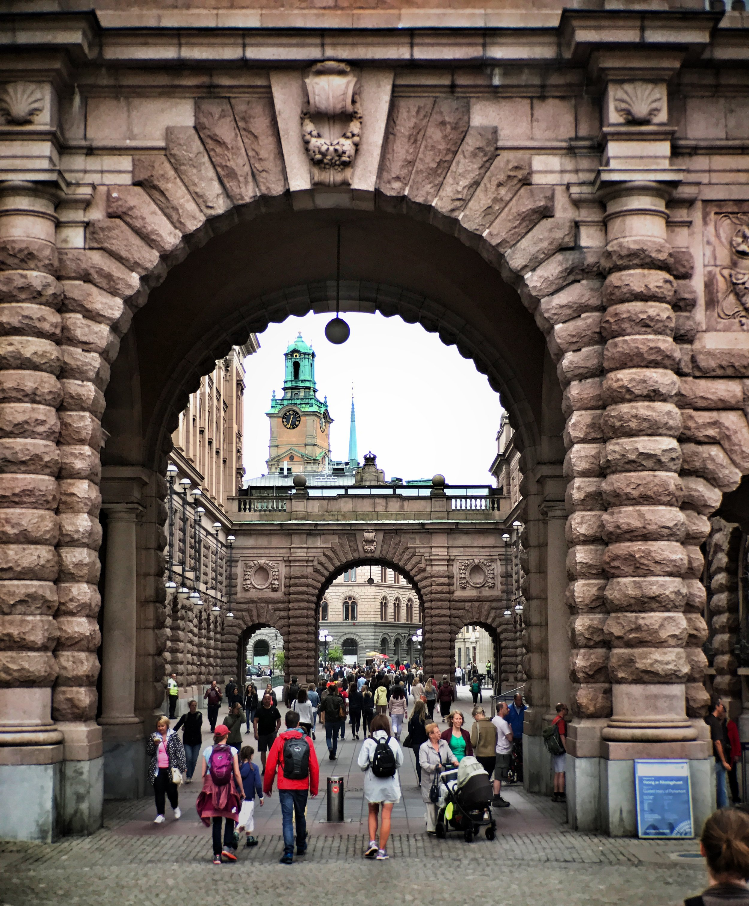 My wife (in gray jacket) entering  Gamla Stan , the old city, in Stockholm