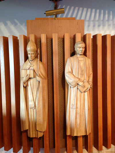 Wooden figures carved and mounted to the Pulpit.