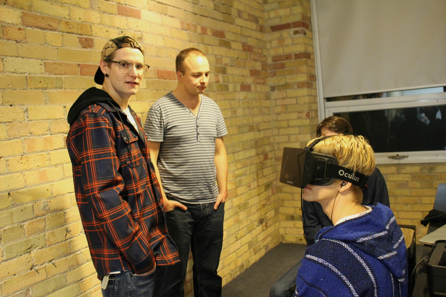 Meetup guests use a demo for the Oculus Rift DK1
