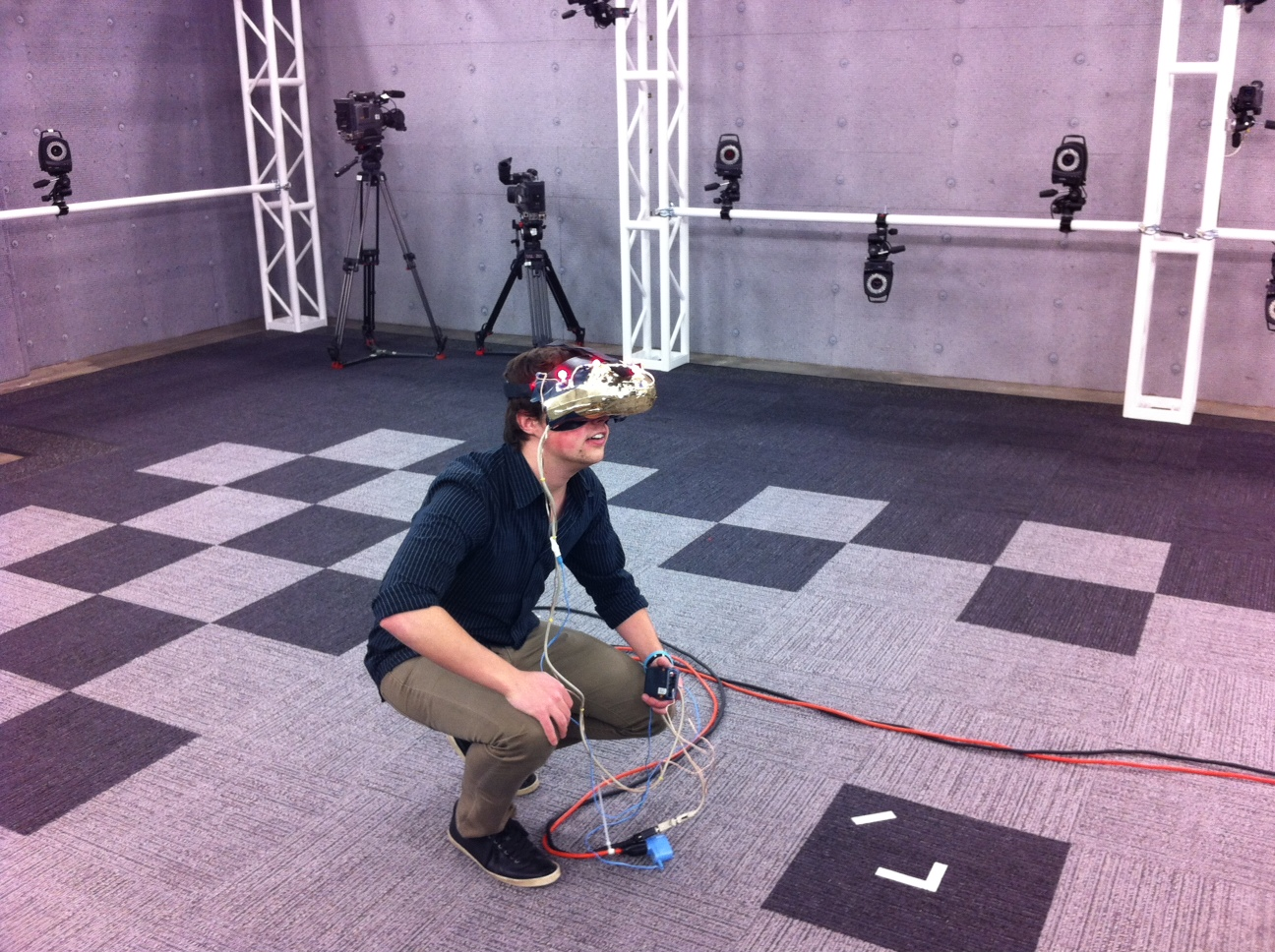 Project Holodeck used motion tracking cameras with the Oculus Rift to try to simulate a Holodeck-like enviroment.
