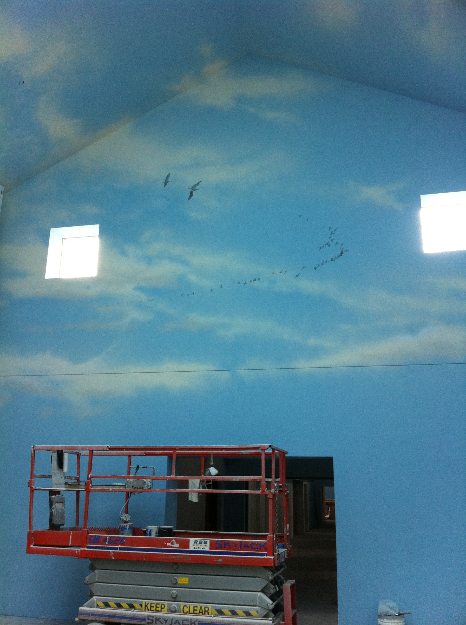 Clouds on end wall of TRF Care Center.