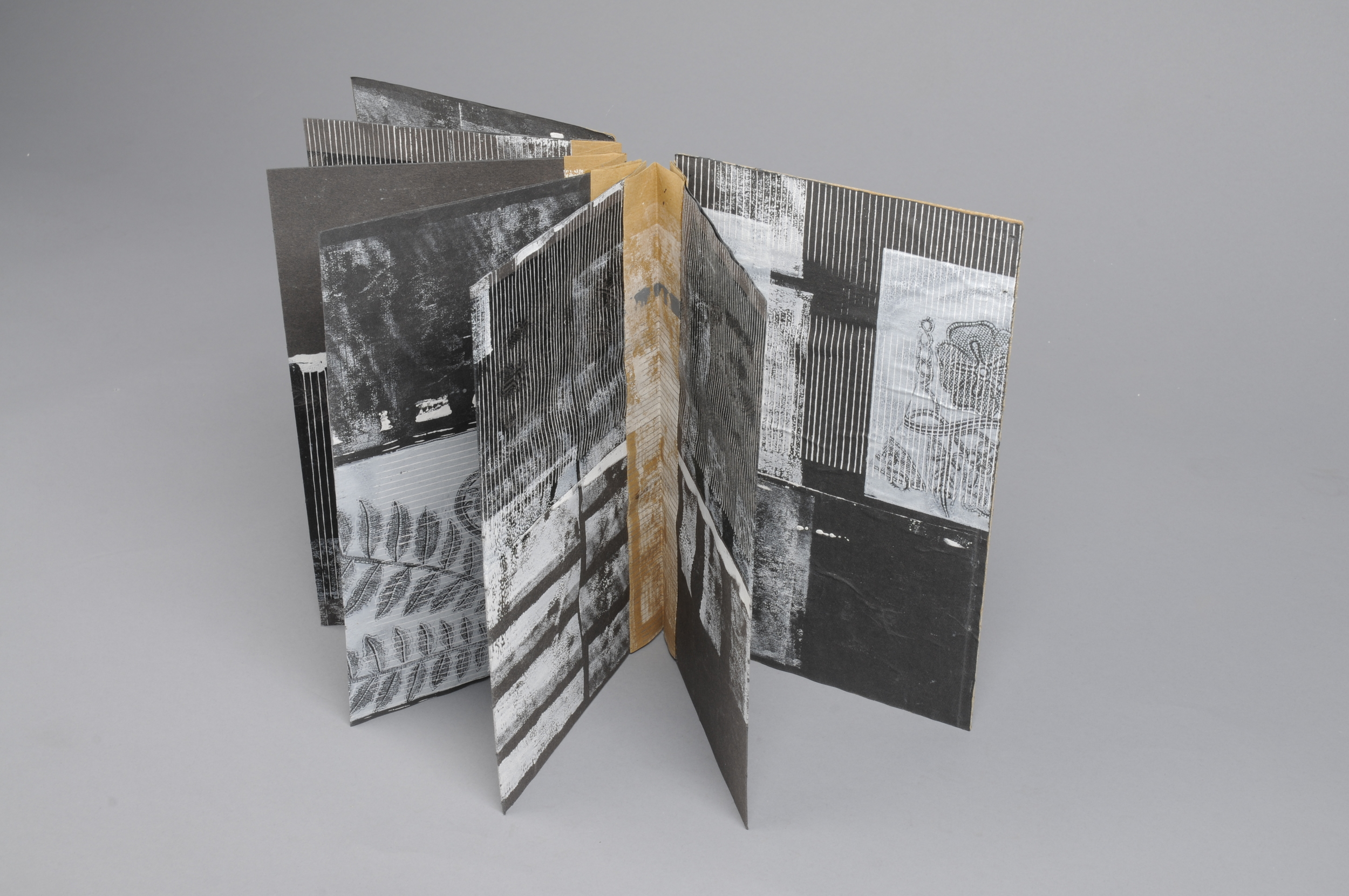 Hand made book with screen and mono print on found paper  2013