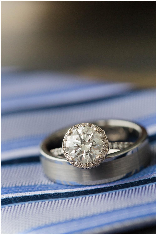 wedding rings on blue striped tie