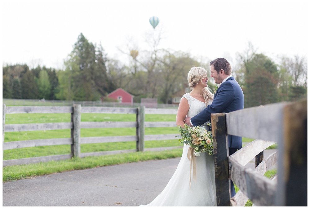 bride and groom portrait with hot air baloons