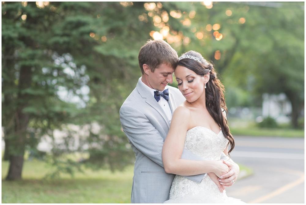backlit photo of bride and groom
