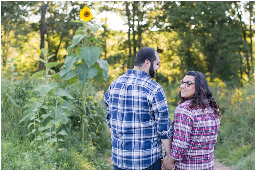 engagement photo of couple at sussex county sunflower maze