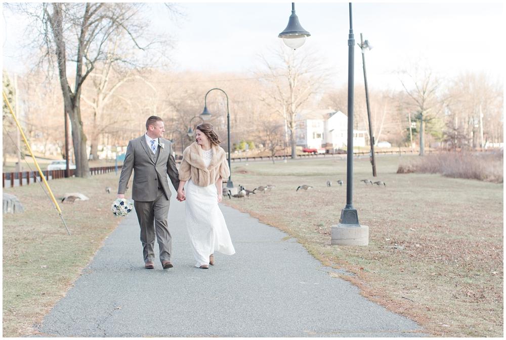 bride and groom walking winter wedding at rockaway park new jersey