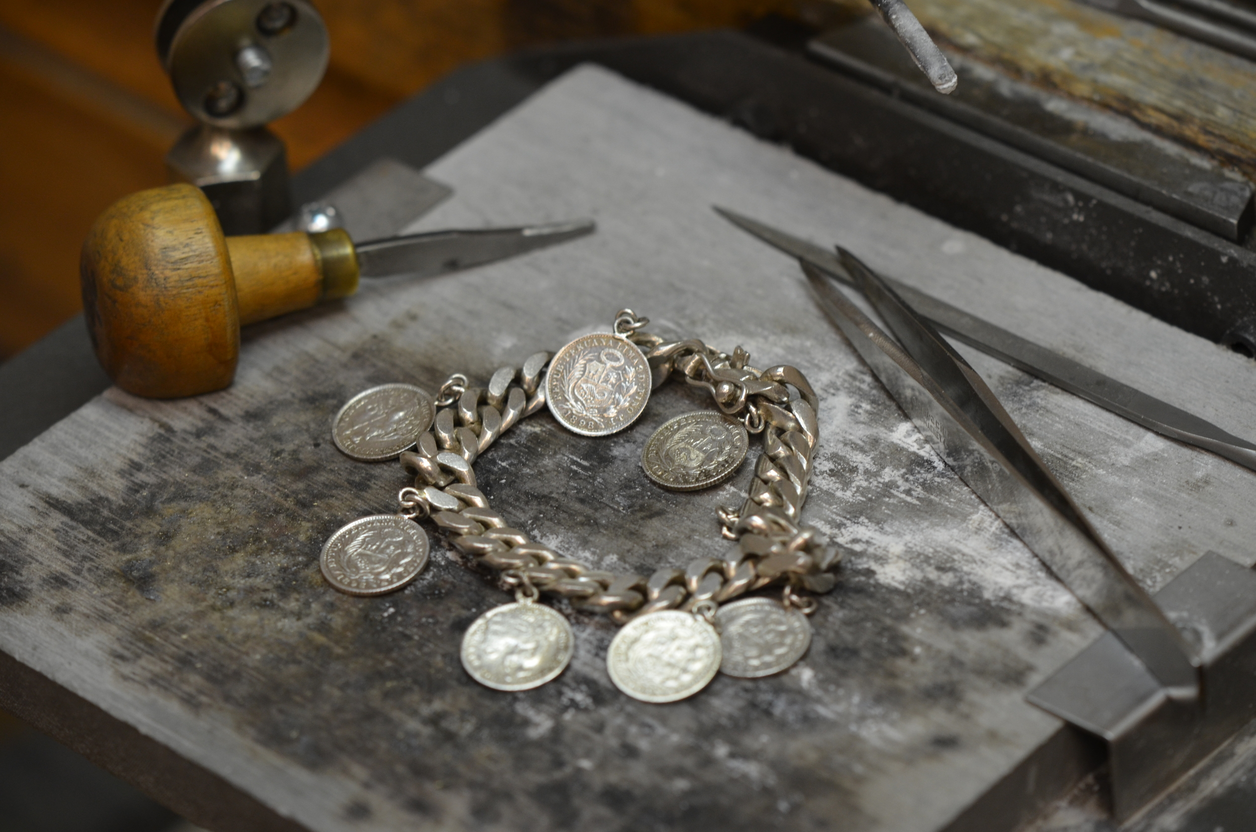 Sterling Silver bracelet with coins.