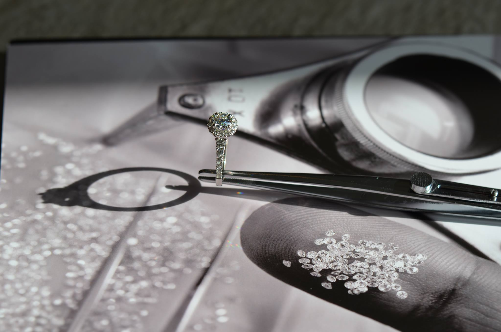 Halo ring with diamonds in black and white.jpg