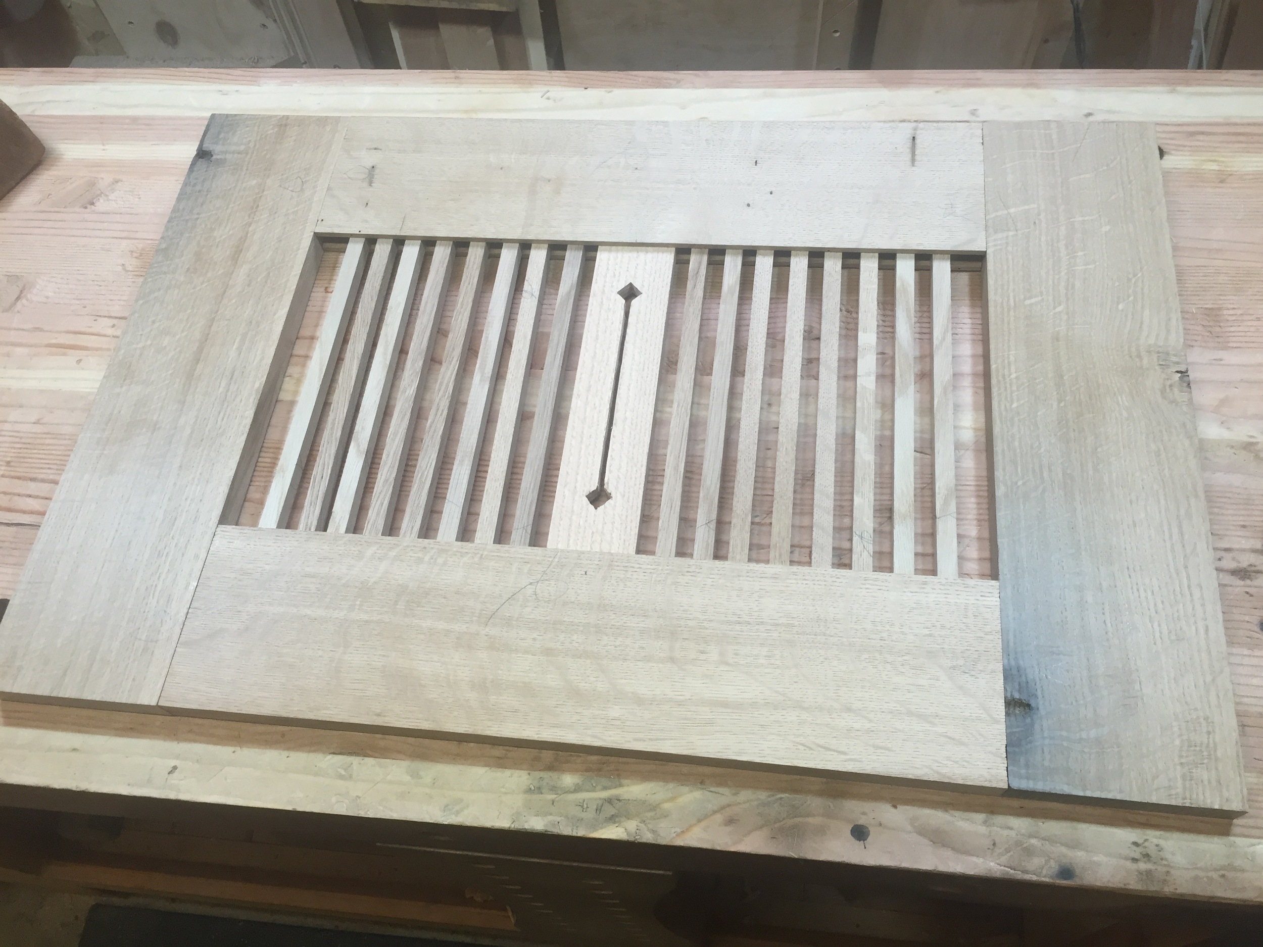 """Test build of the """"spindles"""" sides, with a decorative cutout slat in the middle, which I later ditched."""