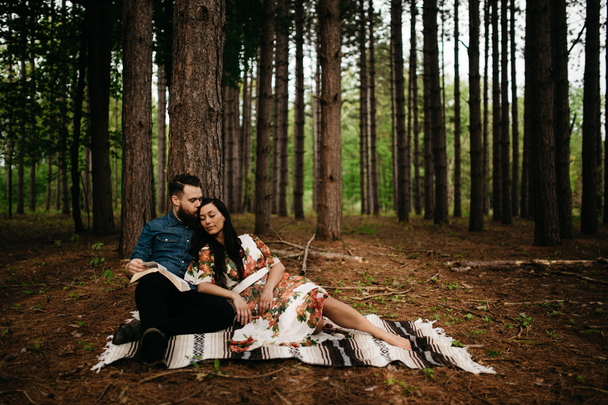 Couple_Reading_In_Woods