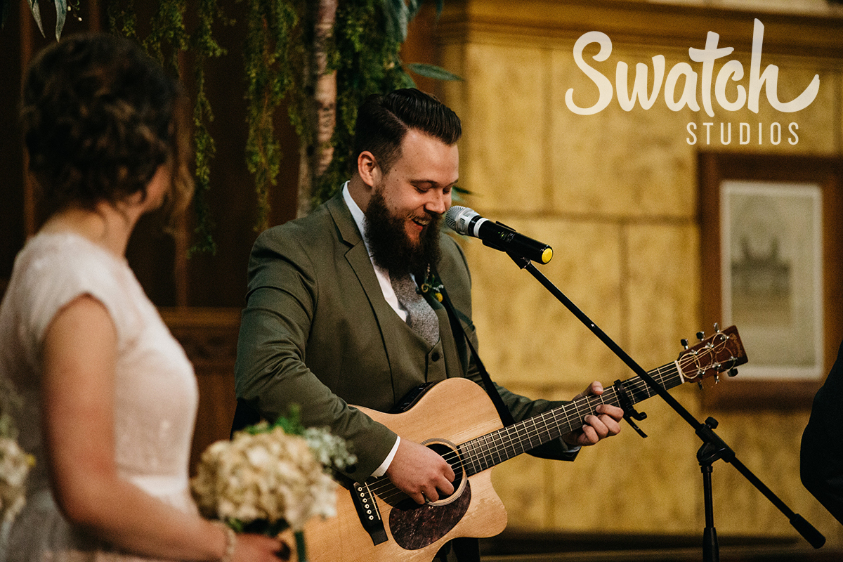 Groom_Playing_Guitar_at_Wedding_Ceremony