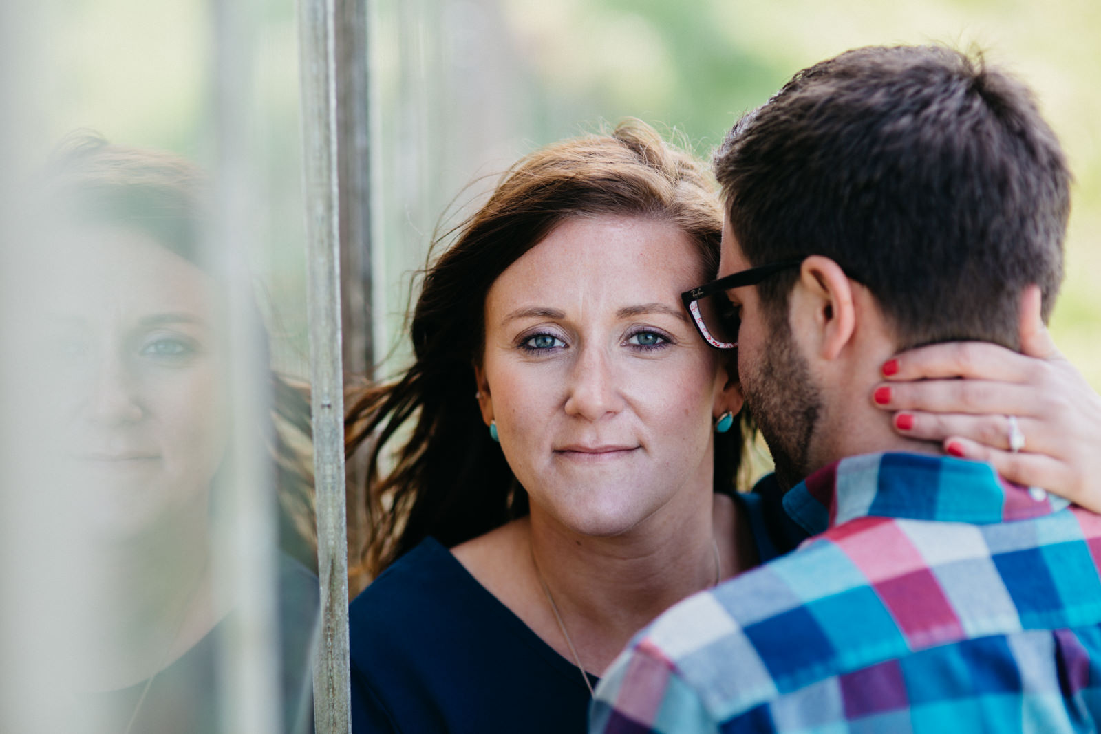 Engagement session near Lake Erie by old overgrown greenhouse.v