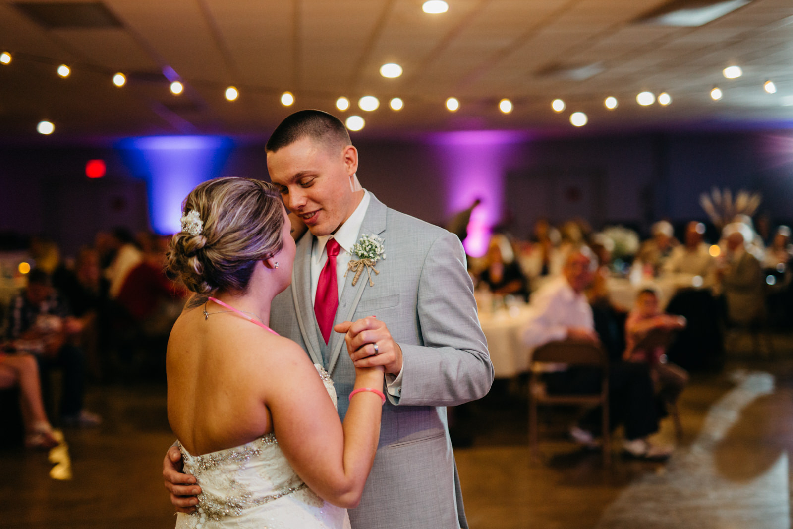 Bride and groom share their first dance at wedding reception