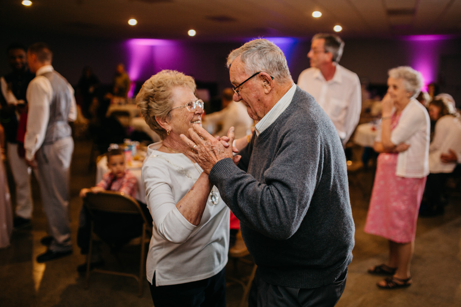 Married couple slow dance at wedding reception