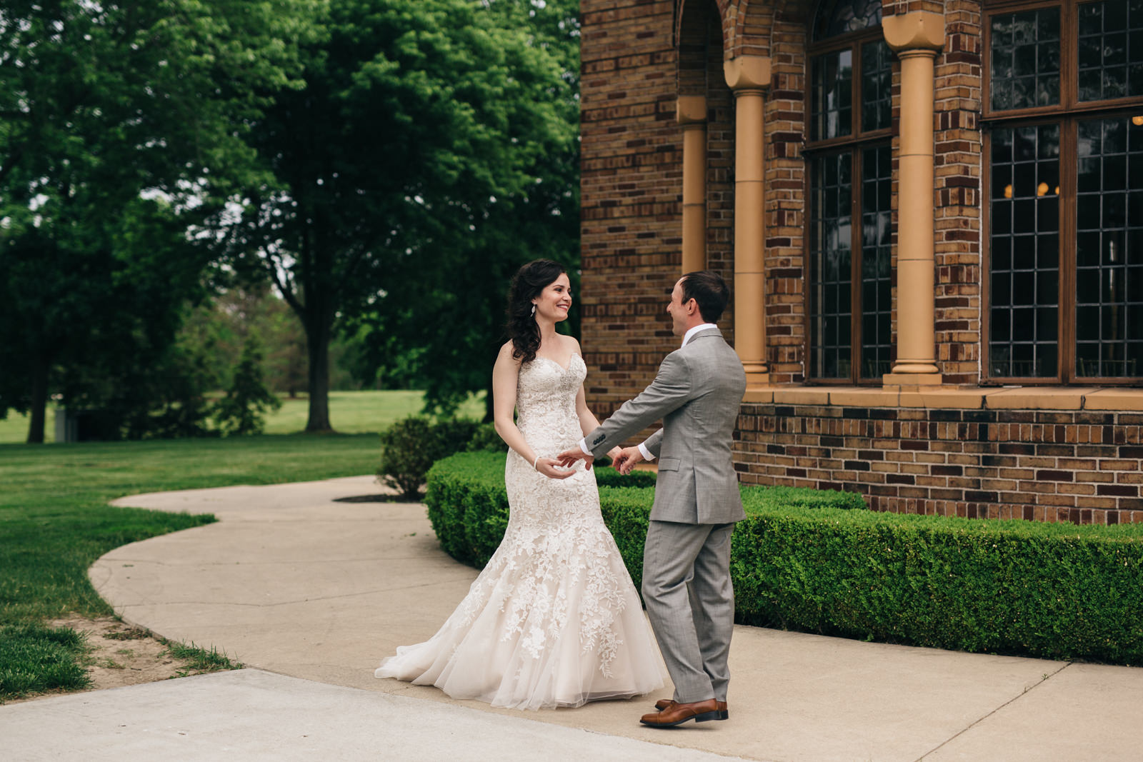 Bride and groom's first look at Nazareth Hall wedding.
