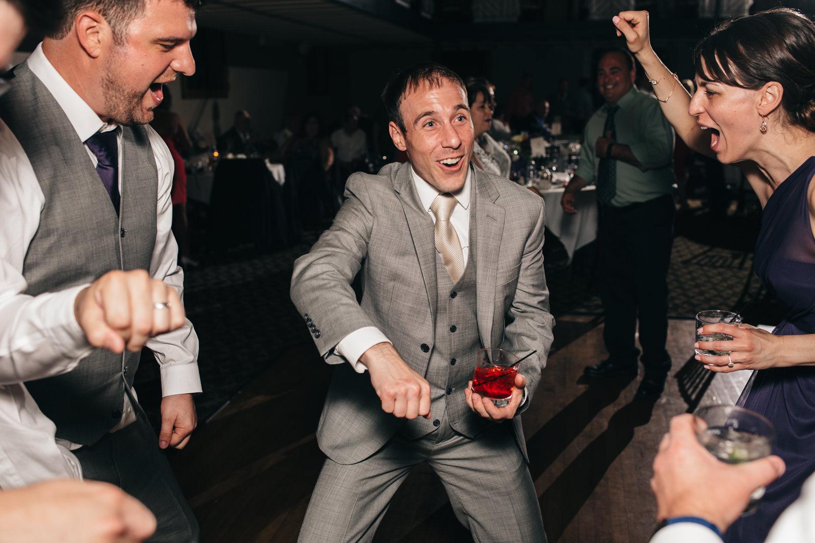 Groom dances at reception at Nazareth Hall Wedding