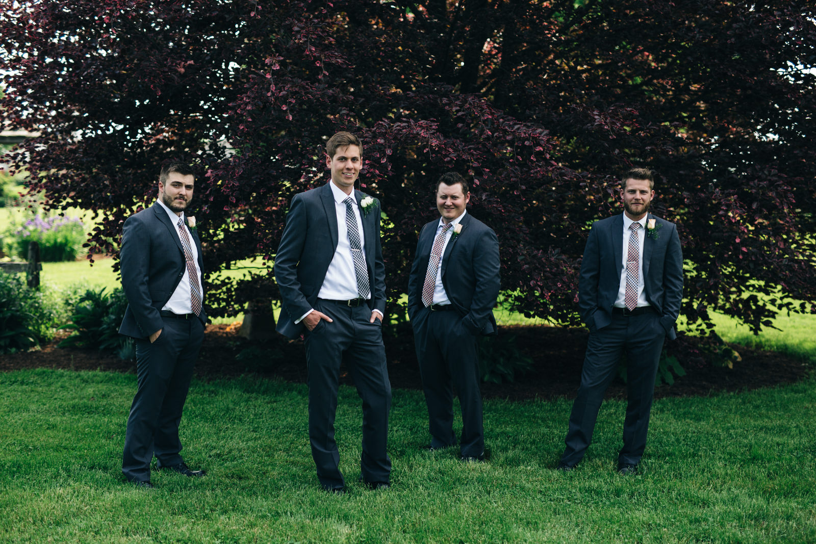 Groomsmen portrait before summer wedding at Quailcrest Farm.