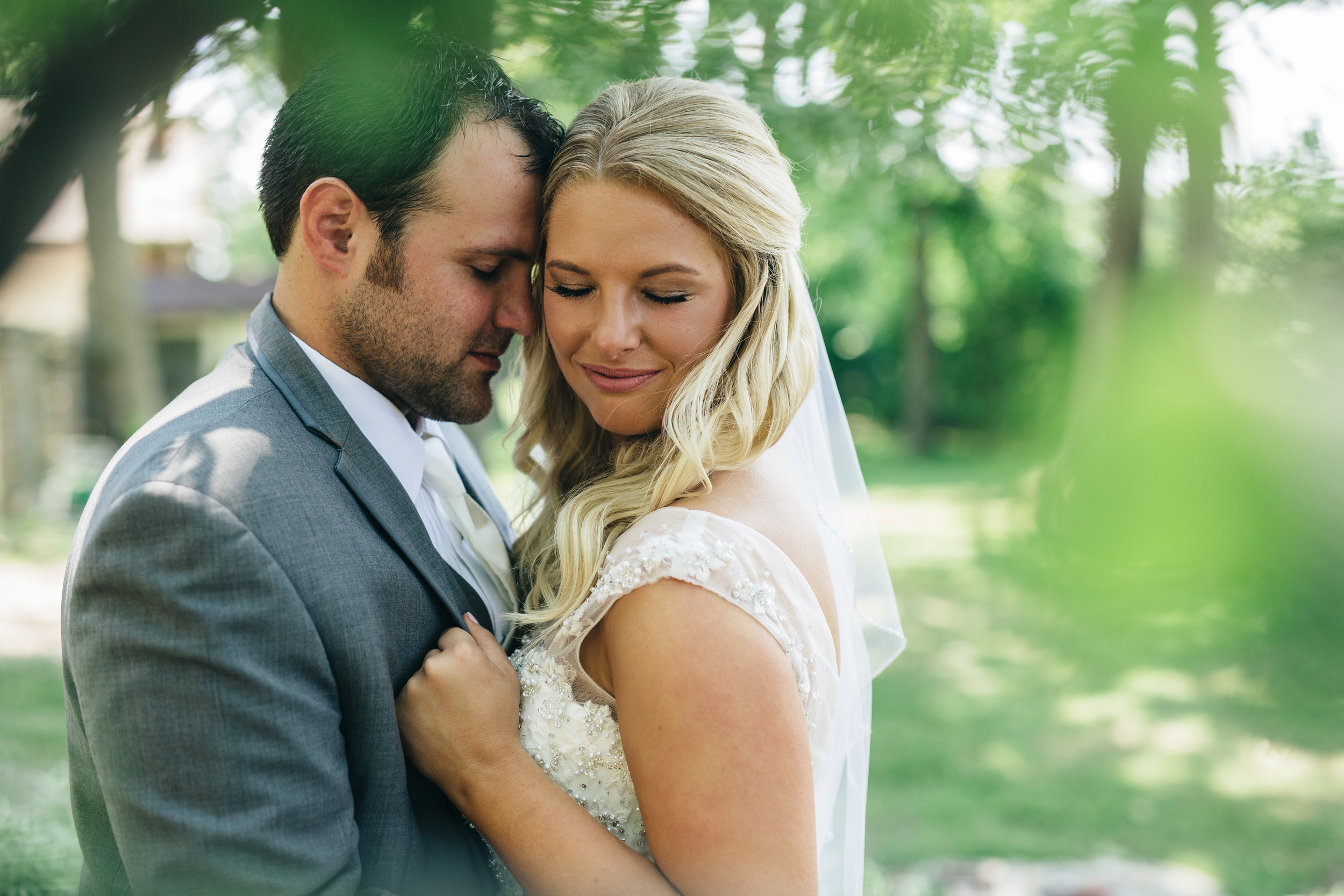 Bride and groom portraits during summer wedding at Oak Shade Grove.