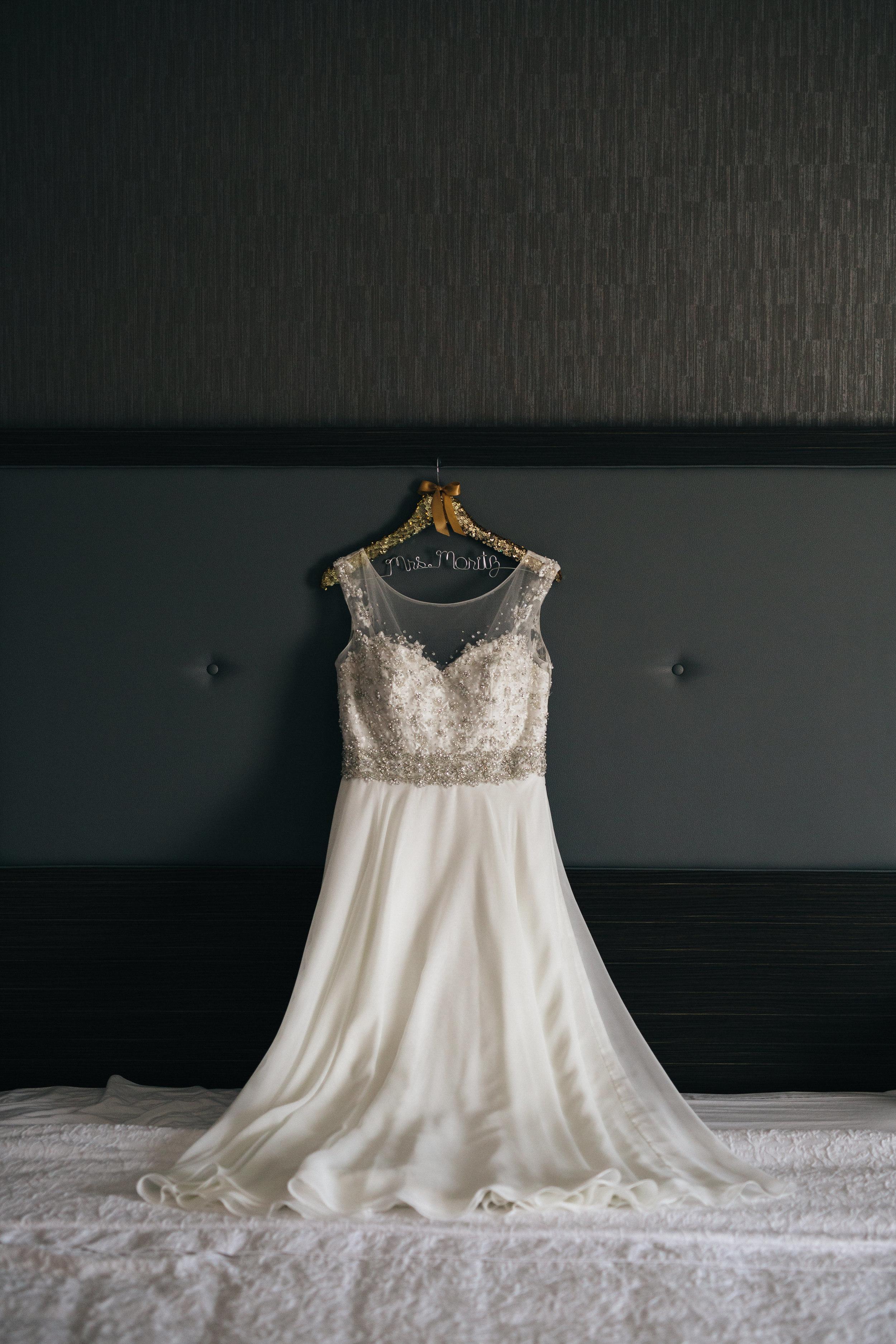 Elegant wedding dress with lace details for summer wedding in Oregon, Ohio.