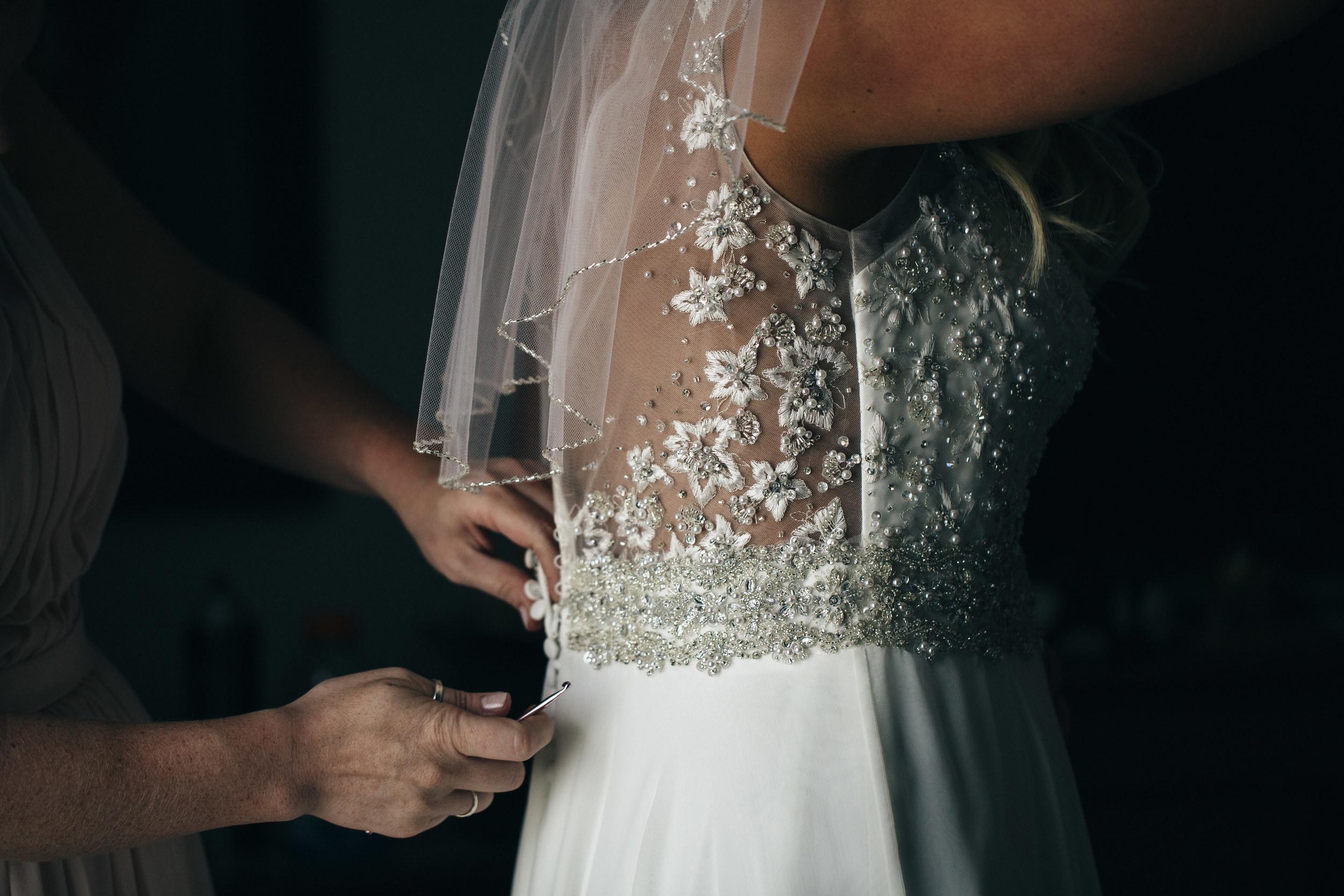 Photo of beautiful lace detail on wedding dress.
