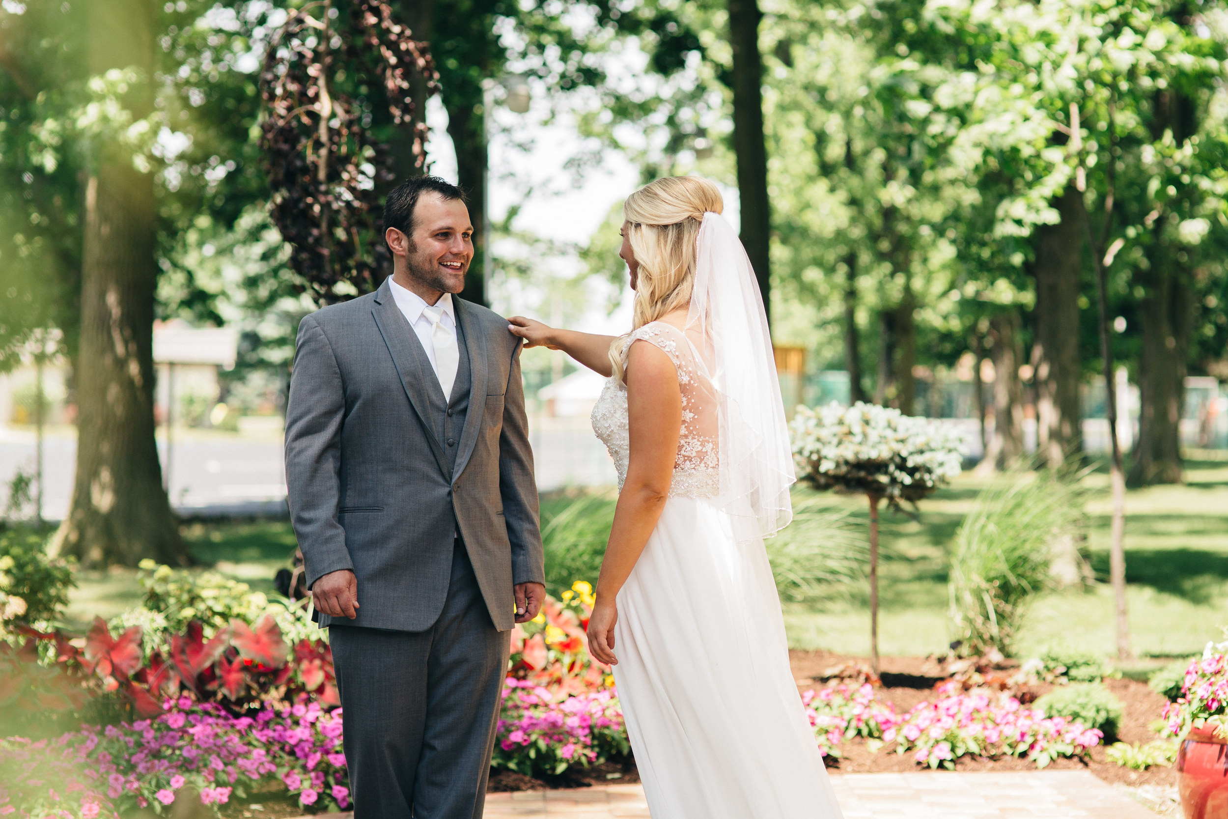 Bride and groom do first look before ceremony at Oak Shade Grove Wedding.