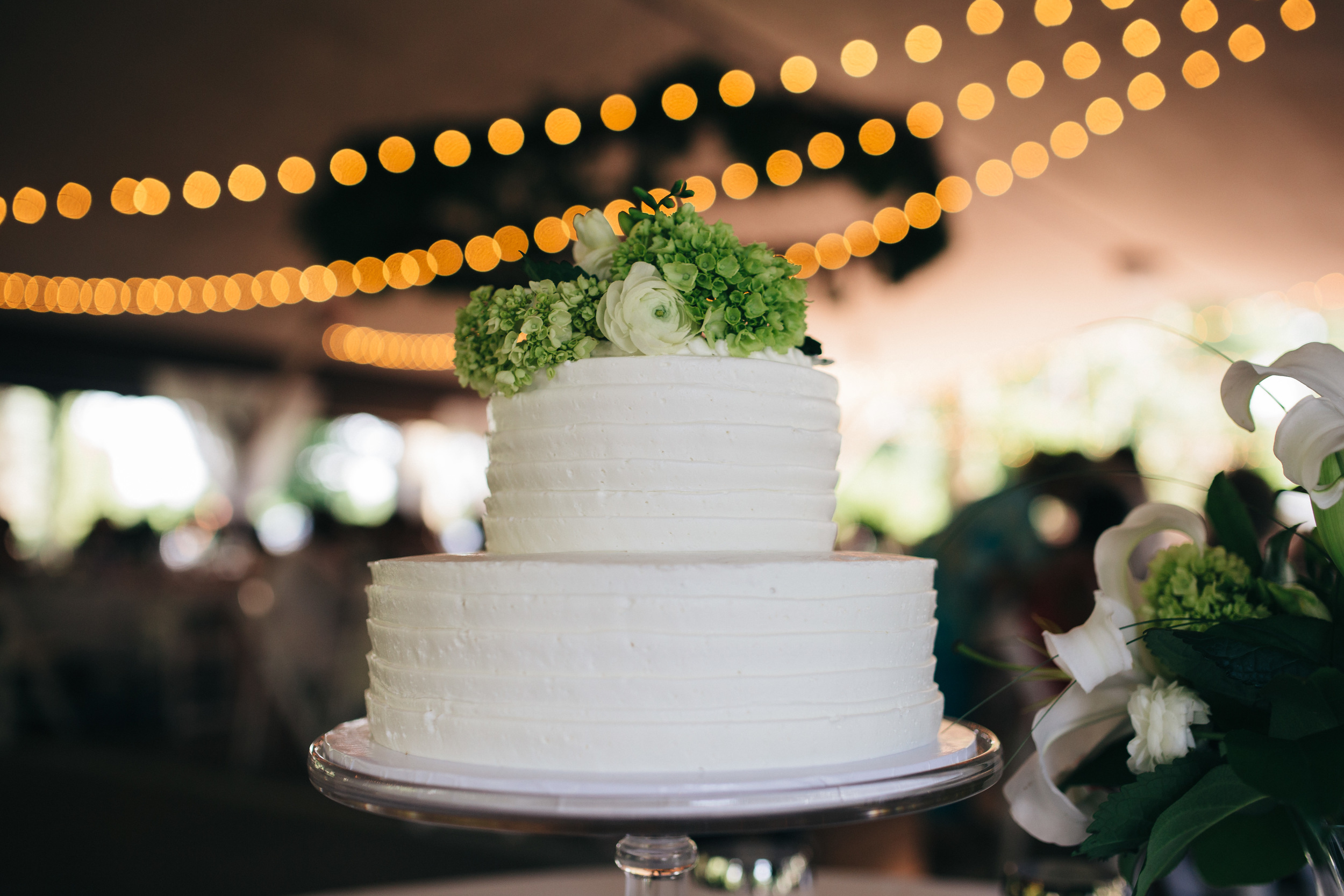 White wedding cake at wedding reception from Eston's Bakery.