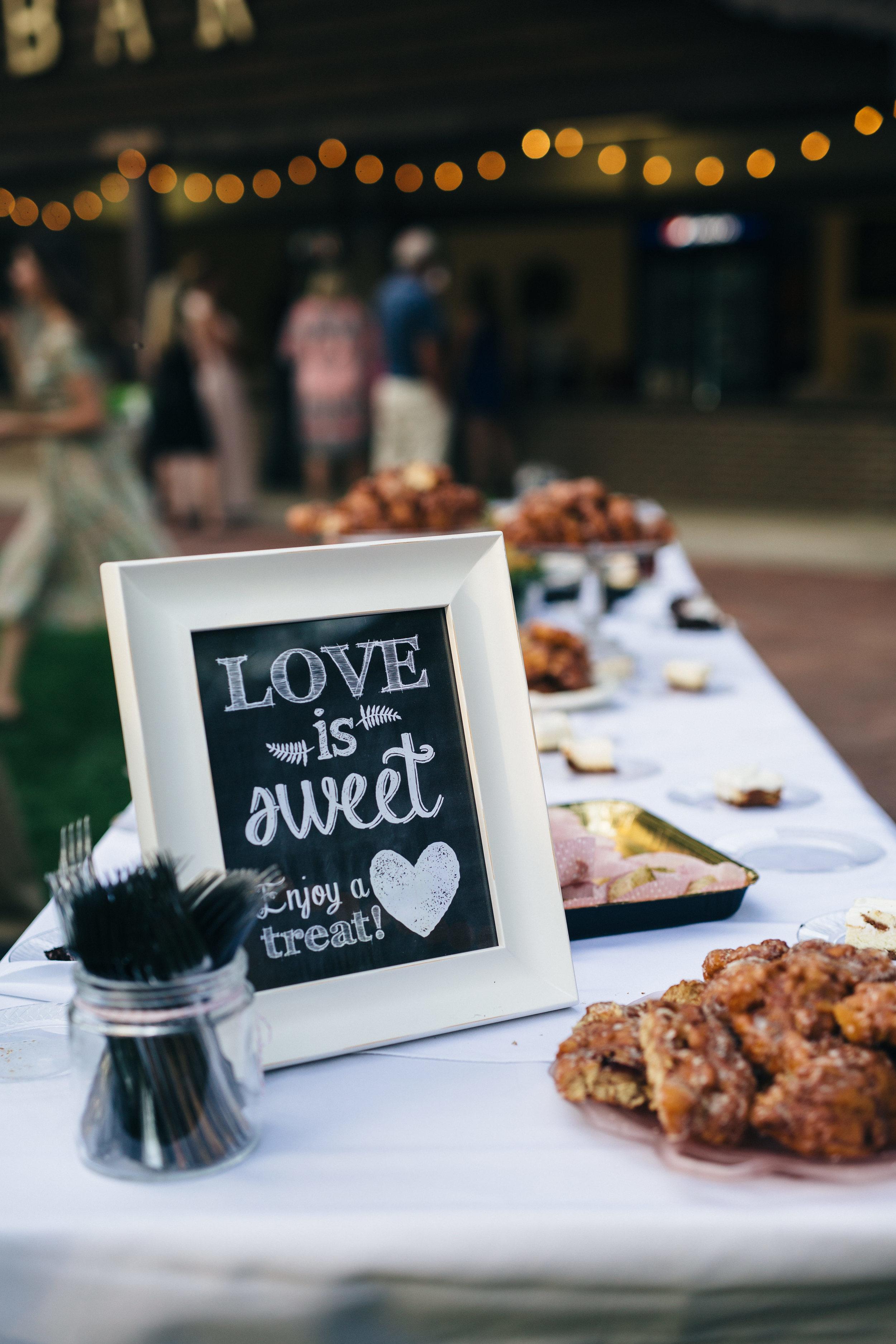 Dessert table at outdoor wedding reception.