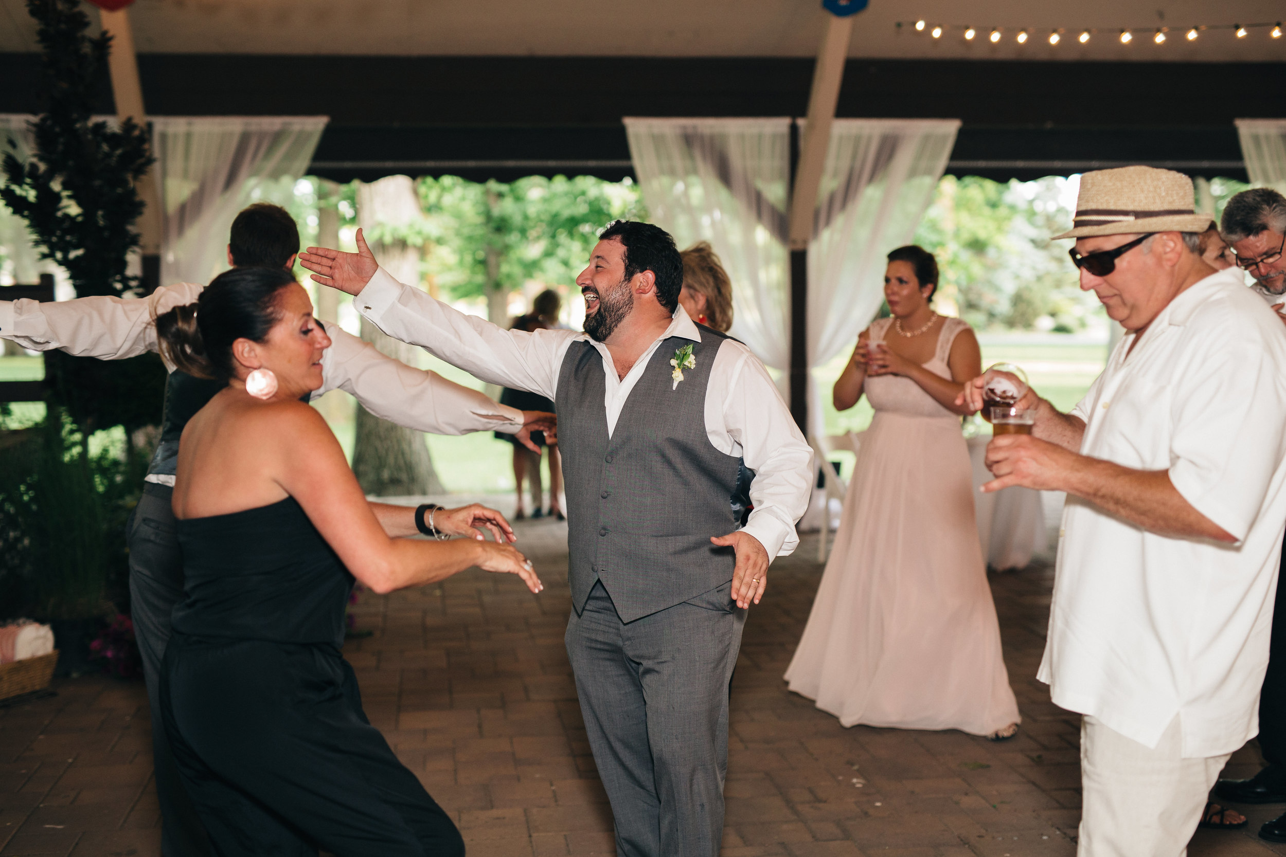 Groomsman dancing to Distant Cousinz band at wedding reception.