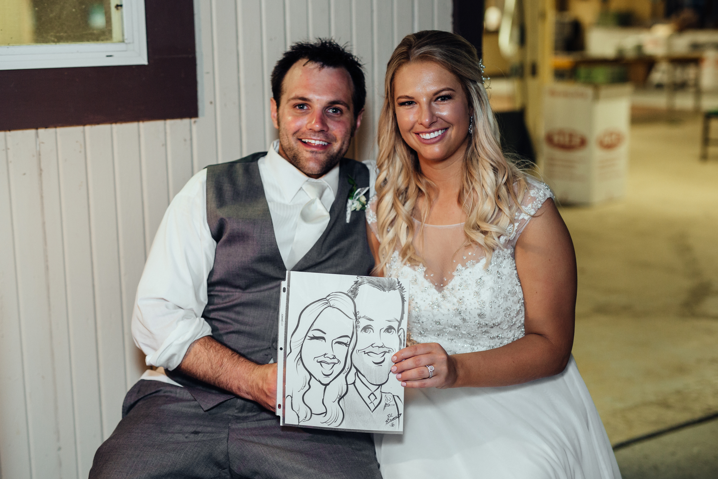 Bride and groom get caricature at wedding reception by Grin-N-Barrett.