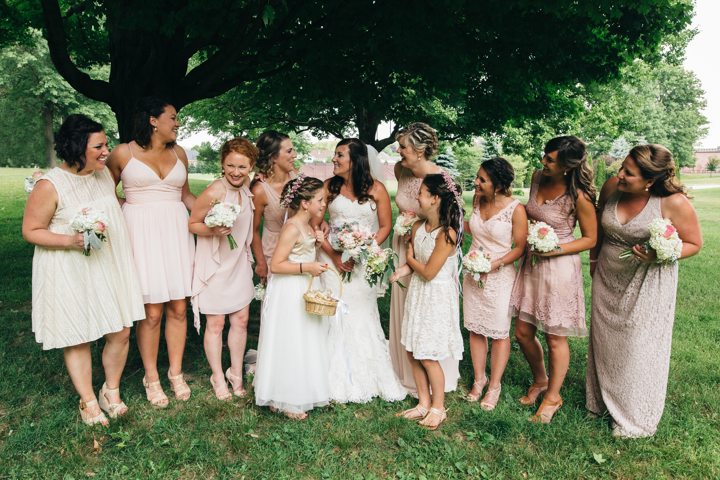 Ivory, blush and taupe mismatched bridesmaids dresses.