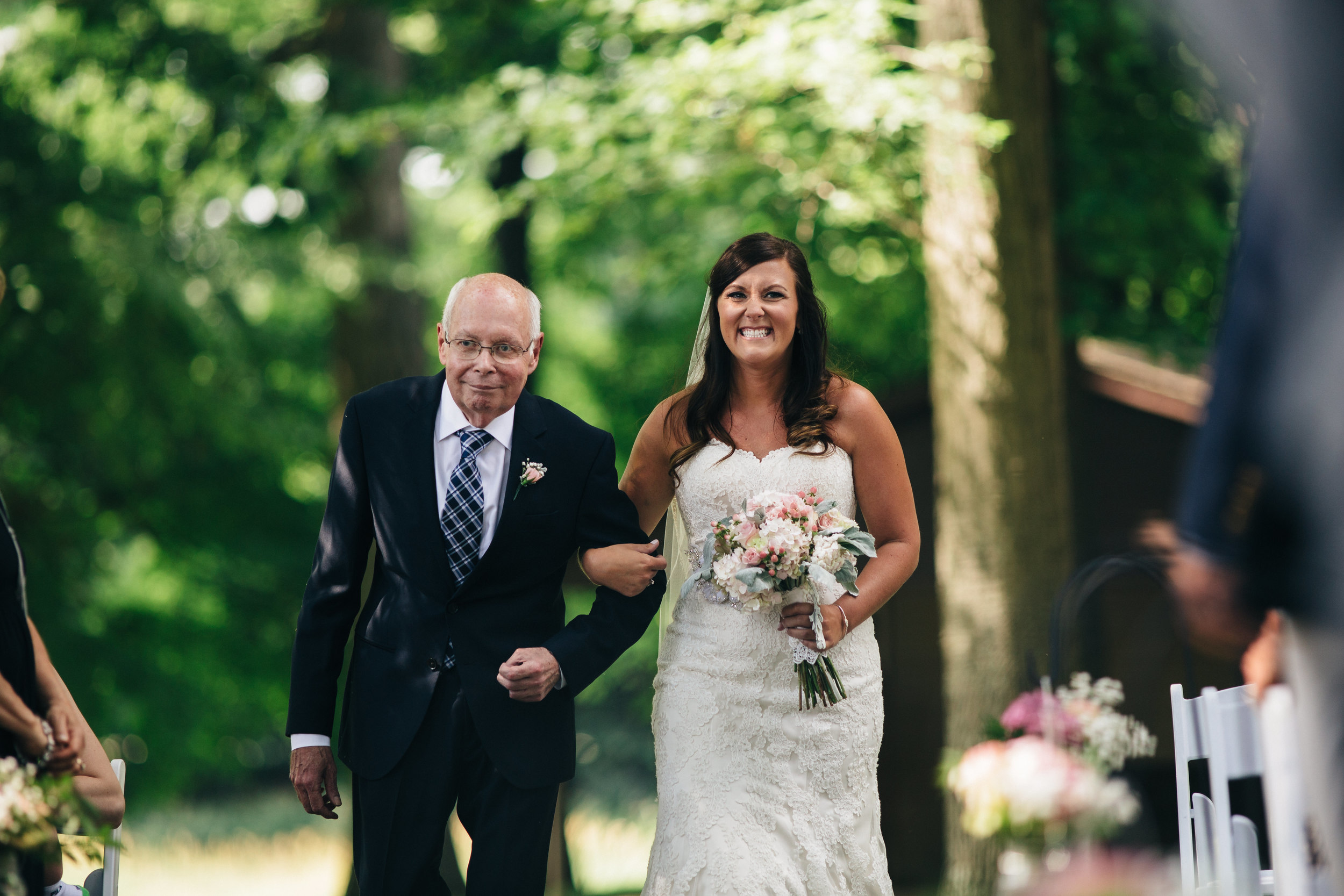 Bride walks down the aisle with her father at Hoover Park.