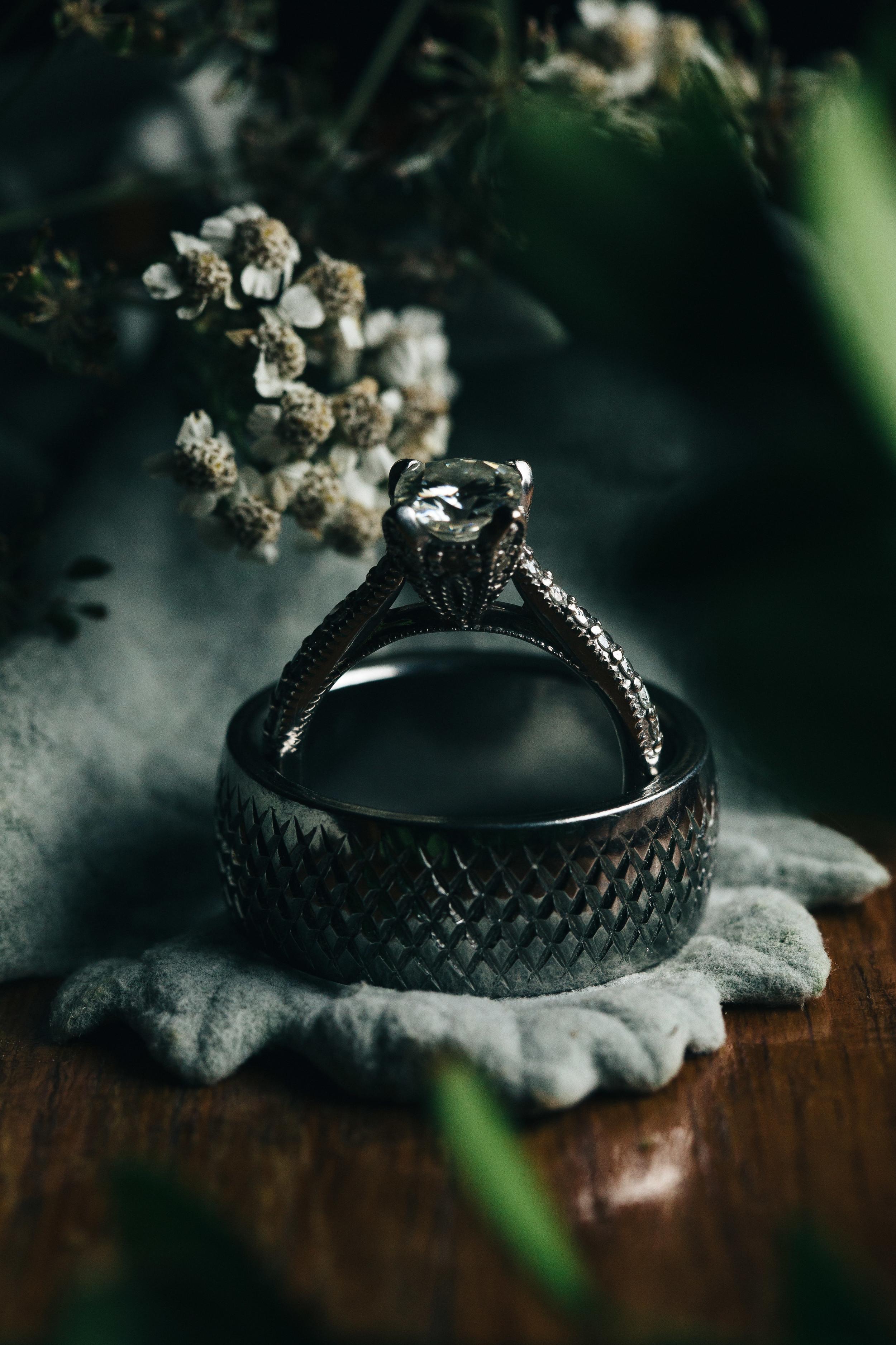 Mens wedding band and women's diamond wedding ring.