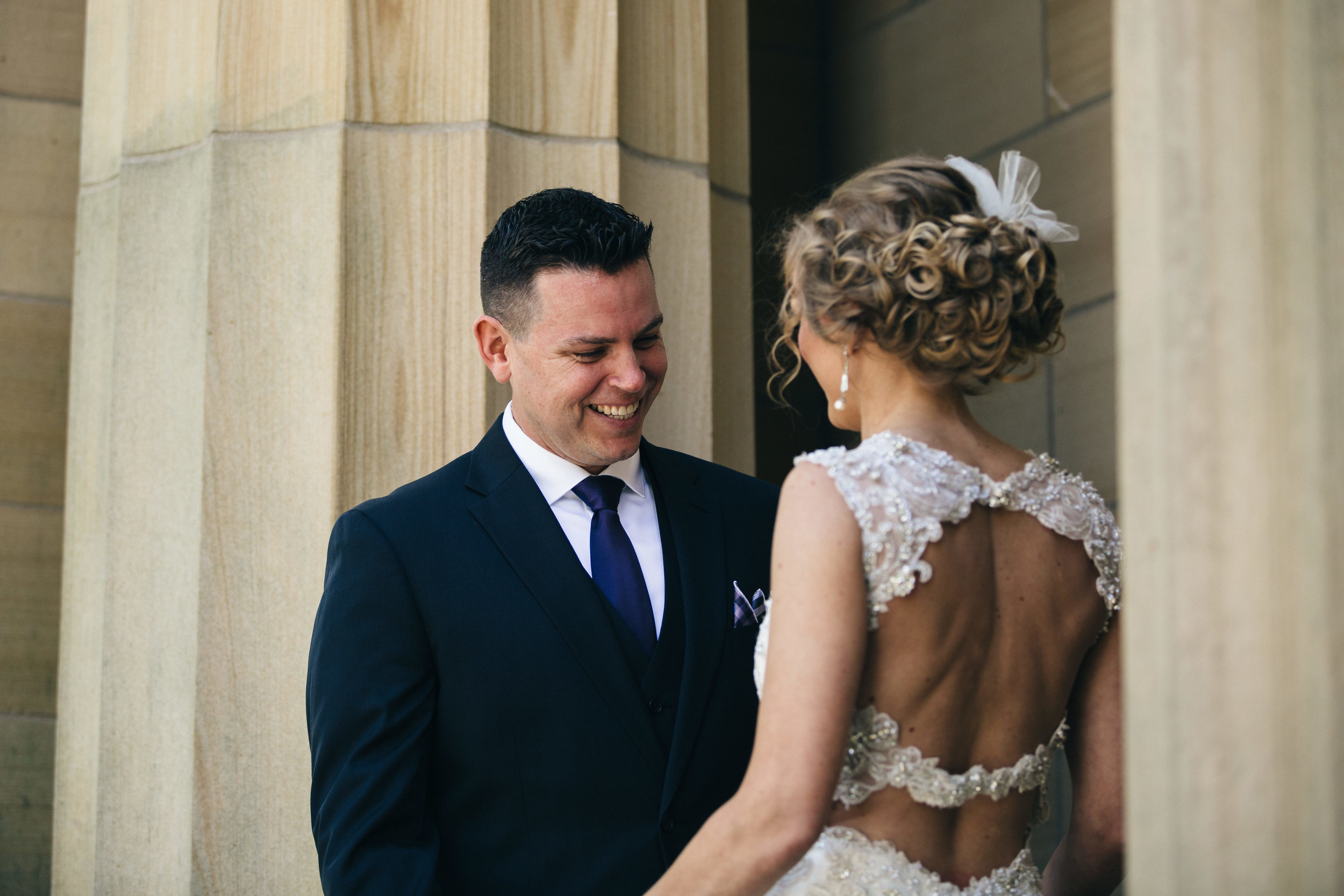 Groom sees bride for first time in Maggie Sottero Design wedding dress.