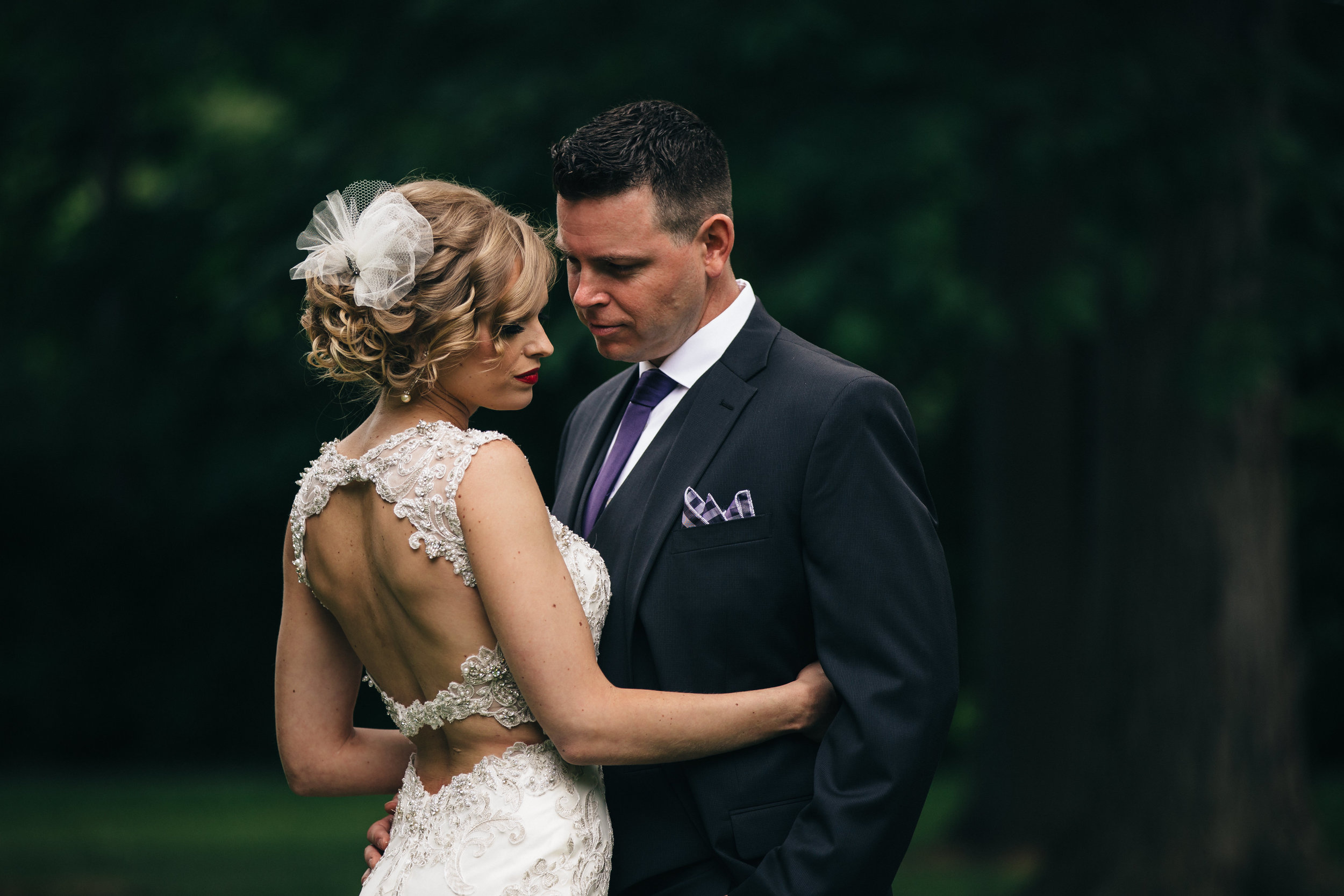 Wedding photography of groom and bride in lace wedding dress from Maggie Sottero Design.