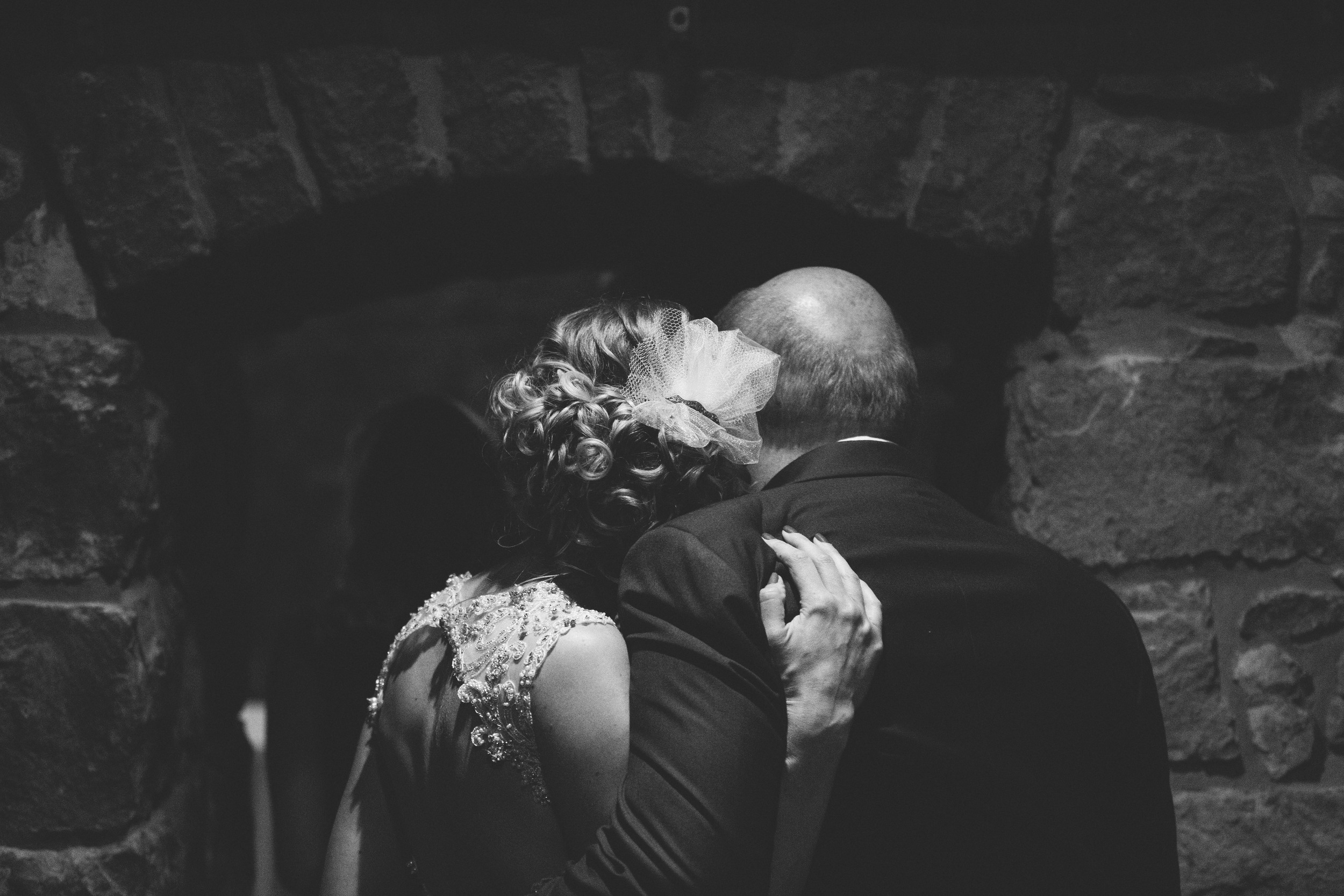 Bride and her father before wedding ceremony in wine cellar at Mon Ami.