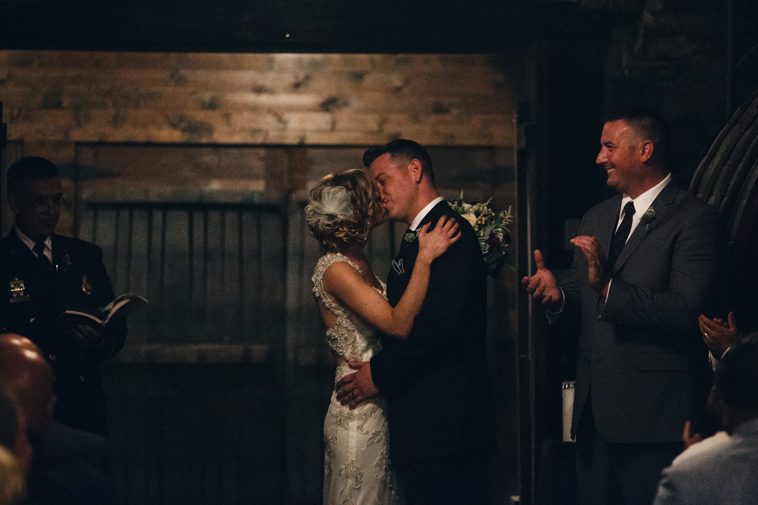 Bride and groom kiss at wedding ceremony in Mon Ami.
