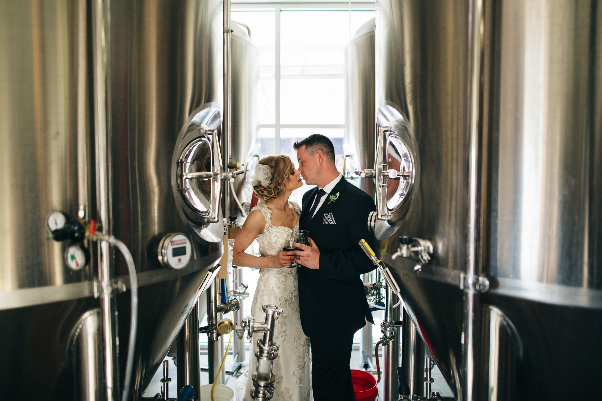 Wedding photography in brewery at Catawba Island Brewery.