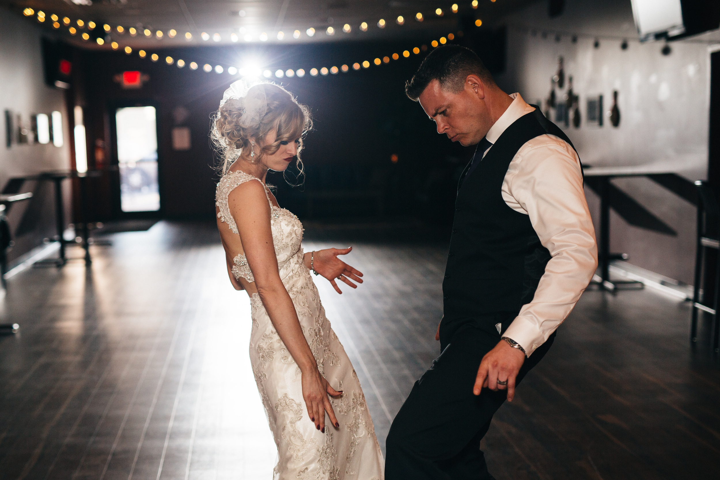 Bride and groom dance at wedding reception.