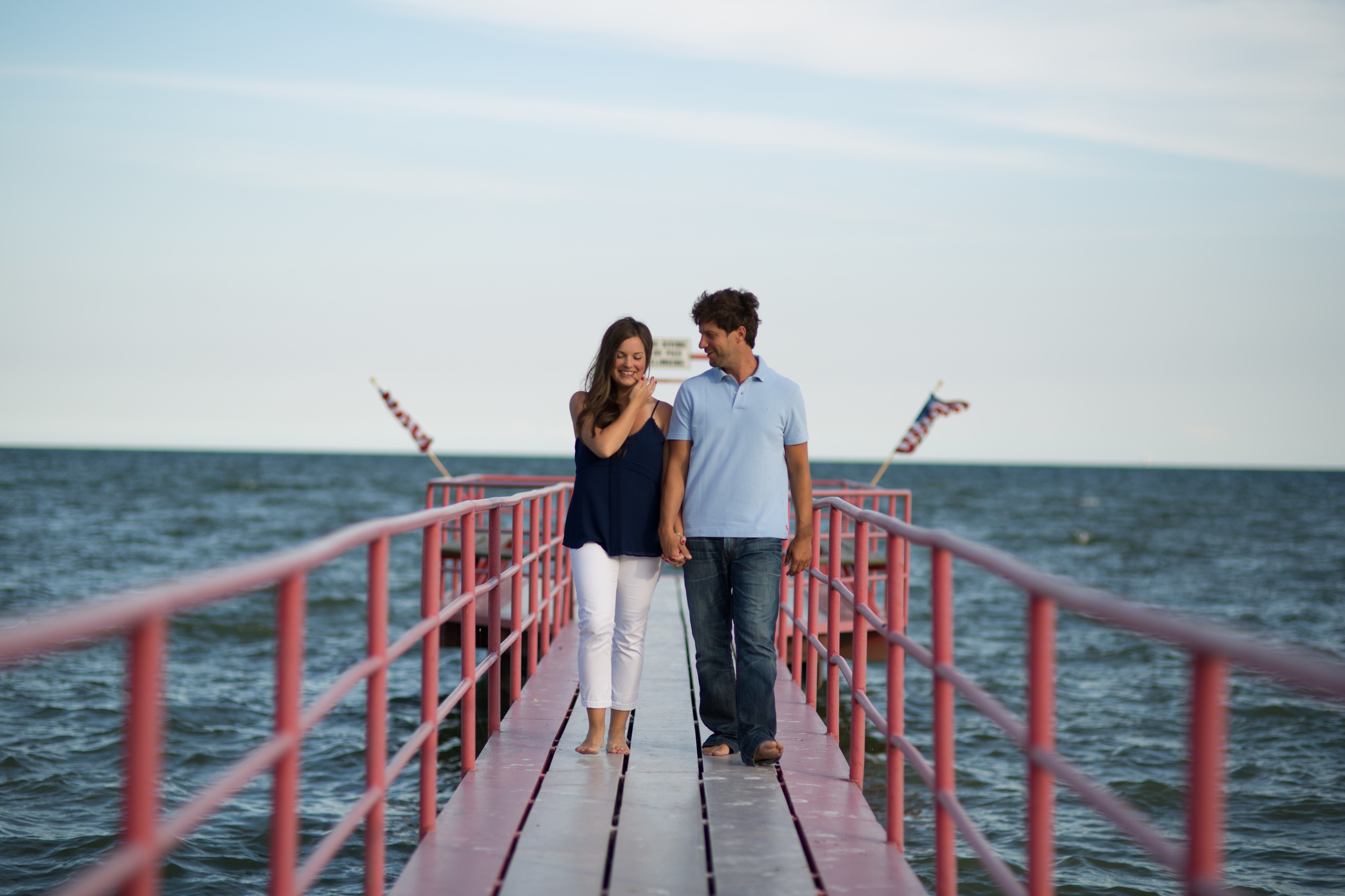Engagement Session on pier of Lake Erie in Michigan.