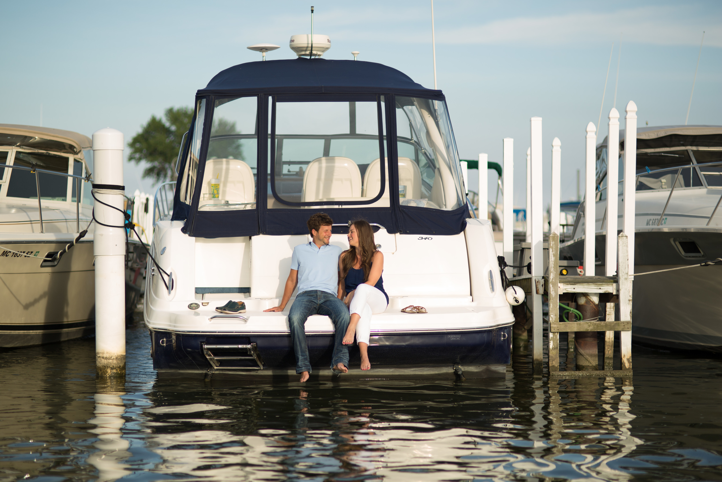 Lake Erie engagement session on a boat at Detroit Beach Boat Club.