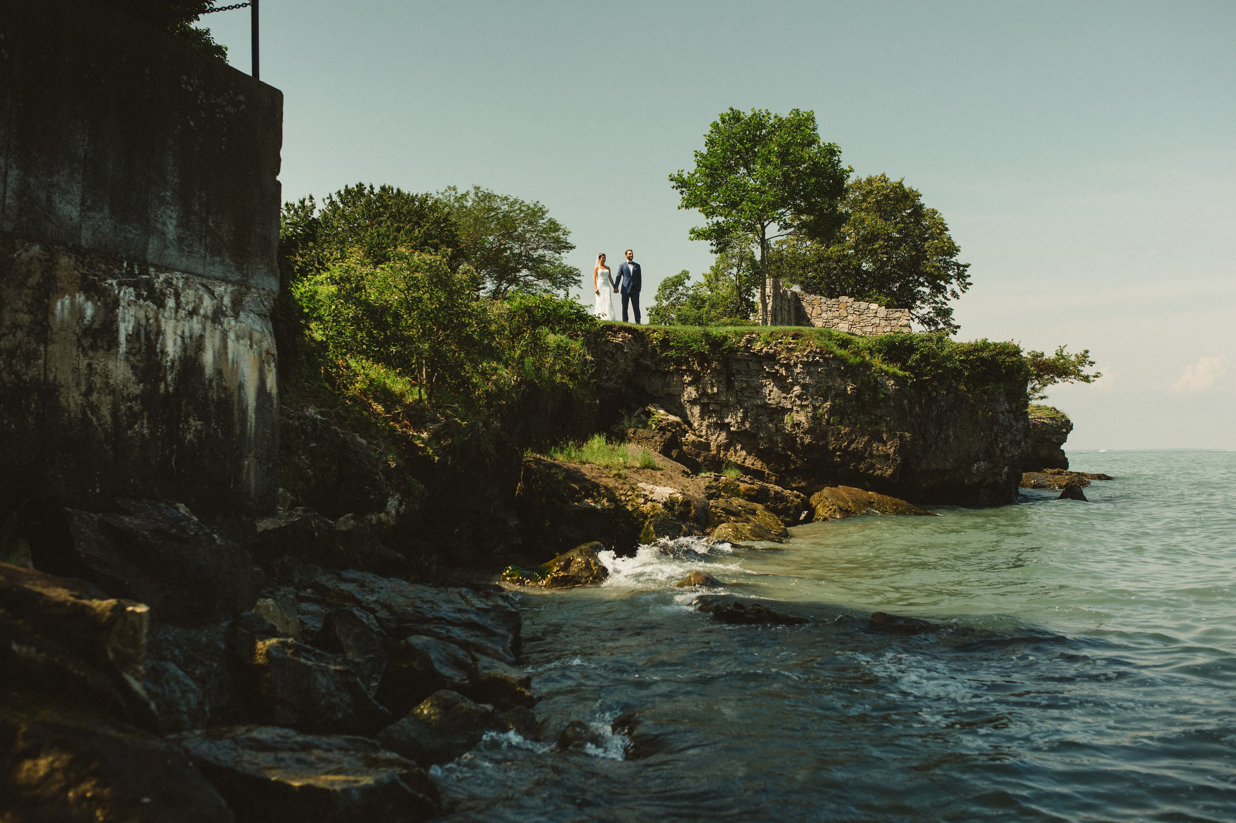 Bride and groom wedding photography by lake erie in Catawba Island, Ohio.