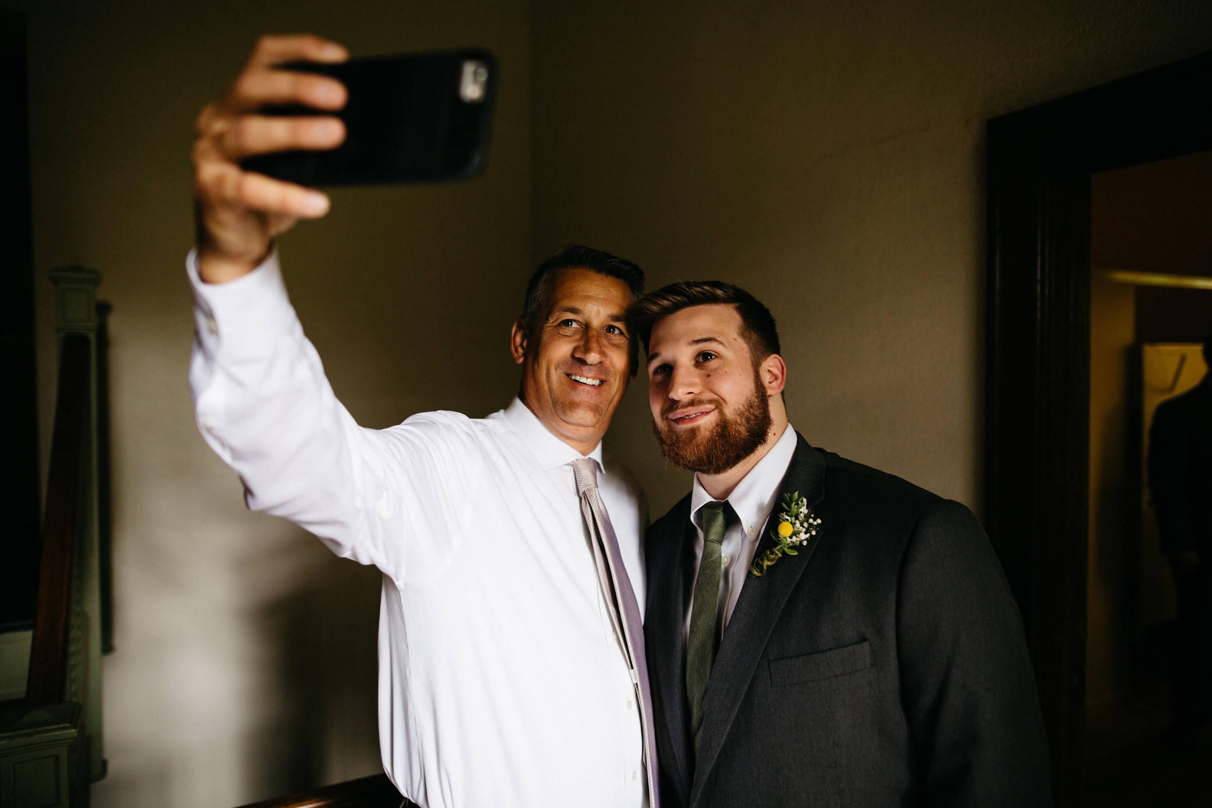 Groomsmen taking a selfie before wedding