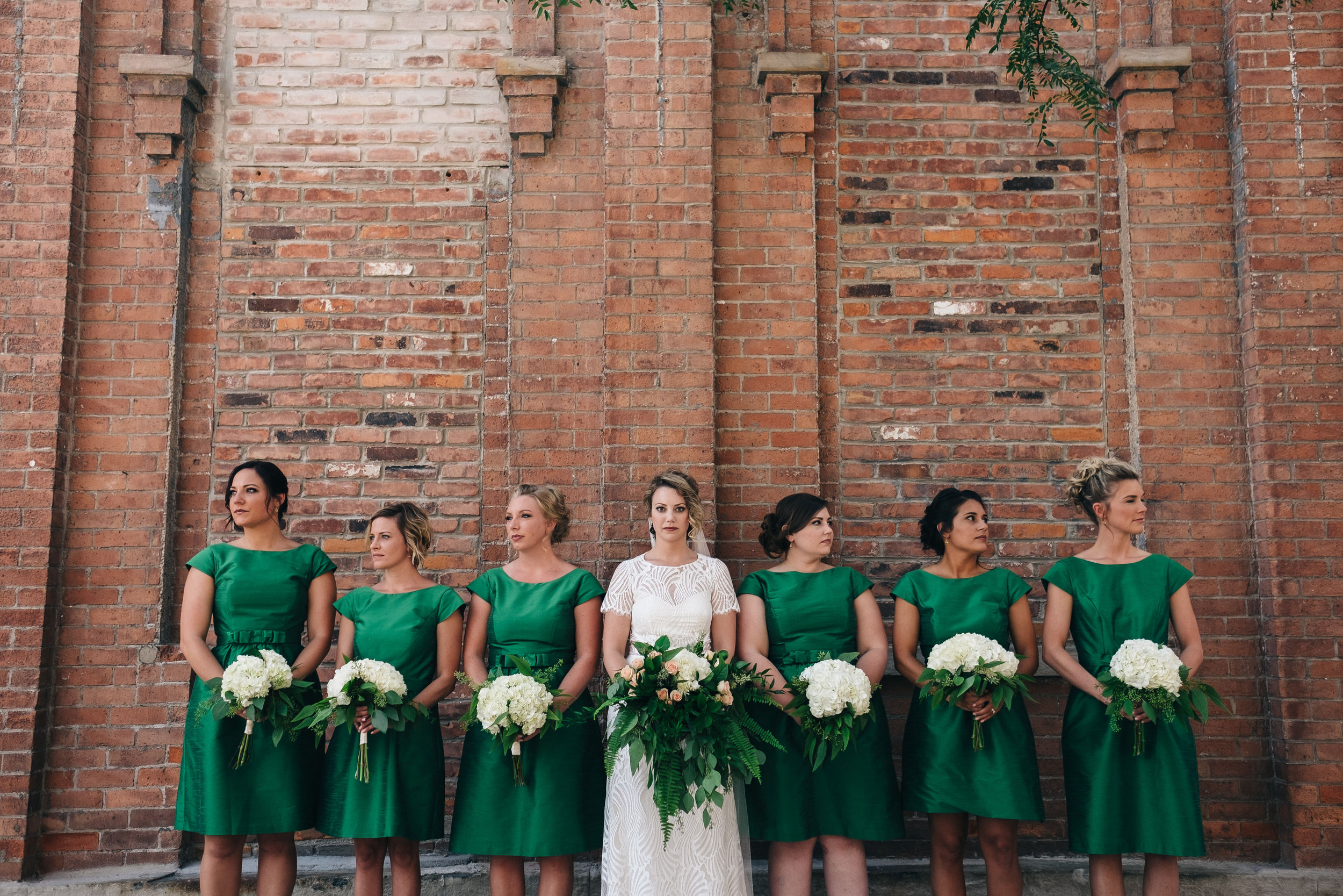 Bridesmaid in emerald green dresses.