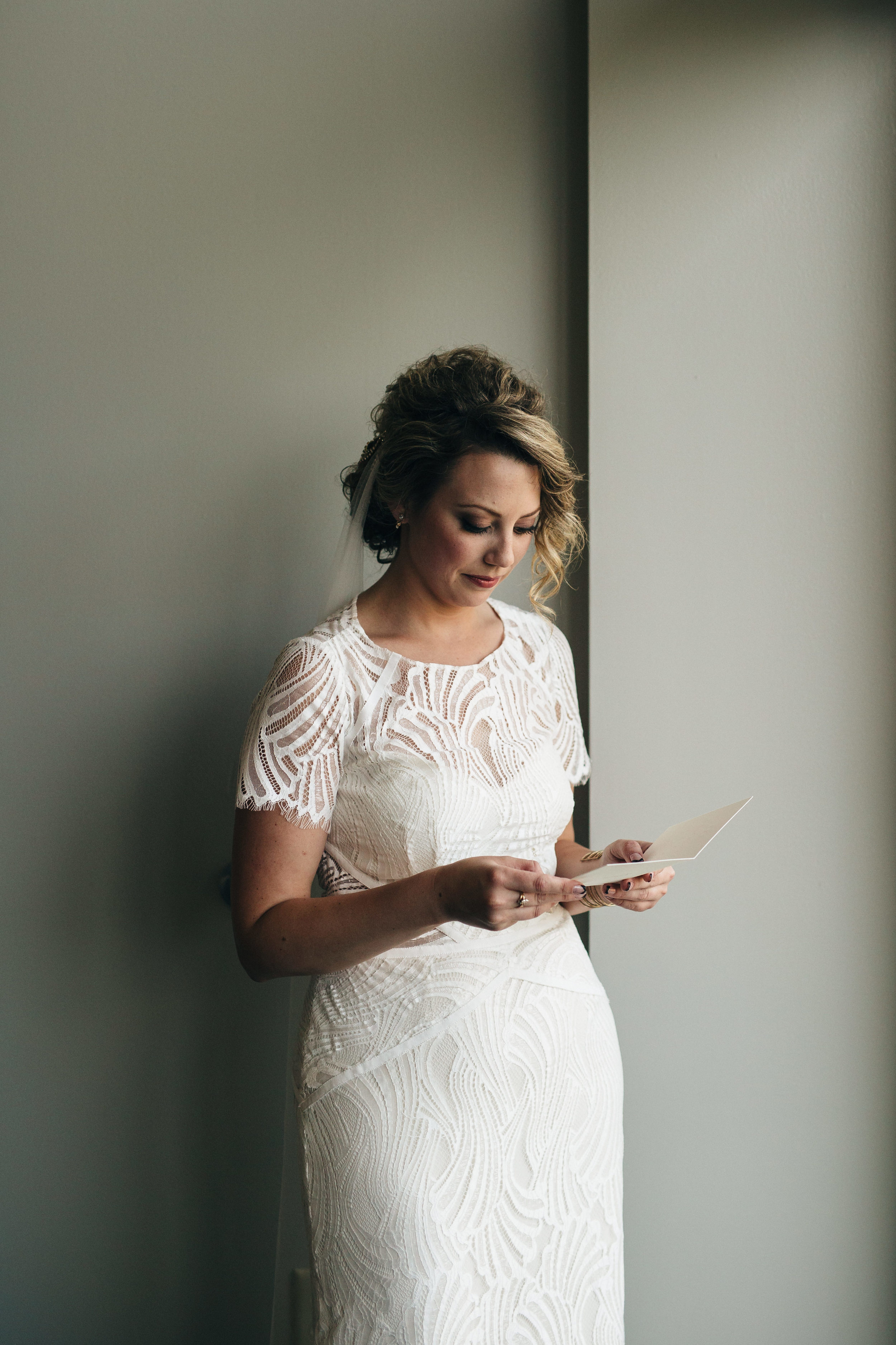 Bride and groom write letters to each other before ceremony.