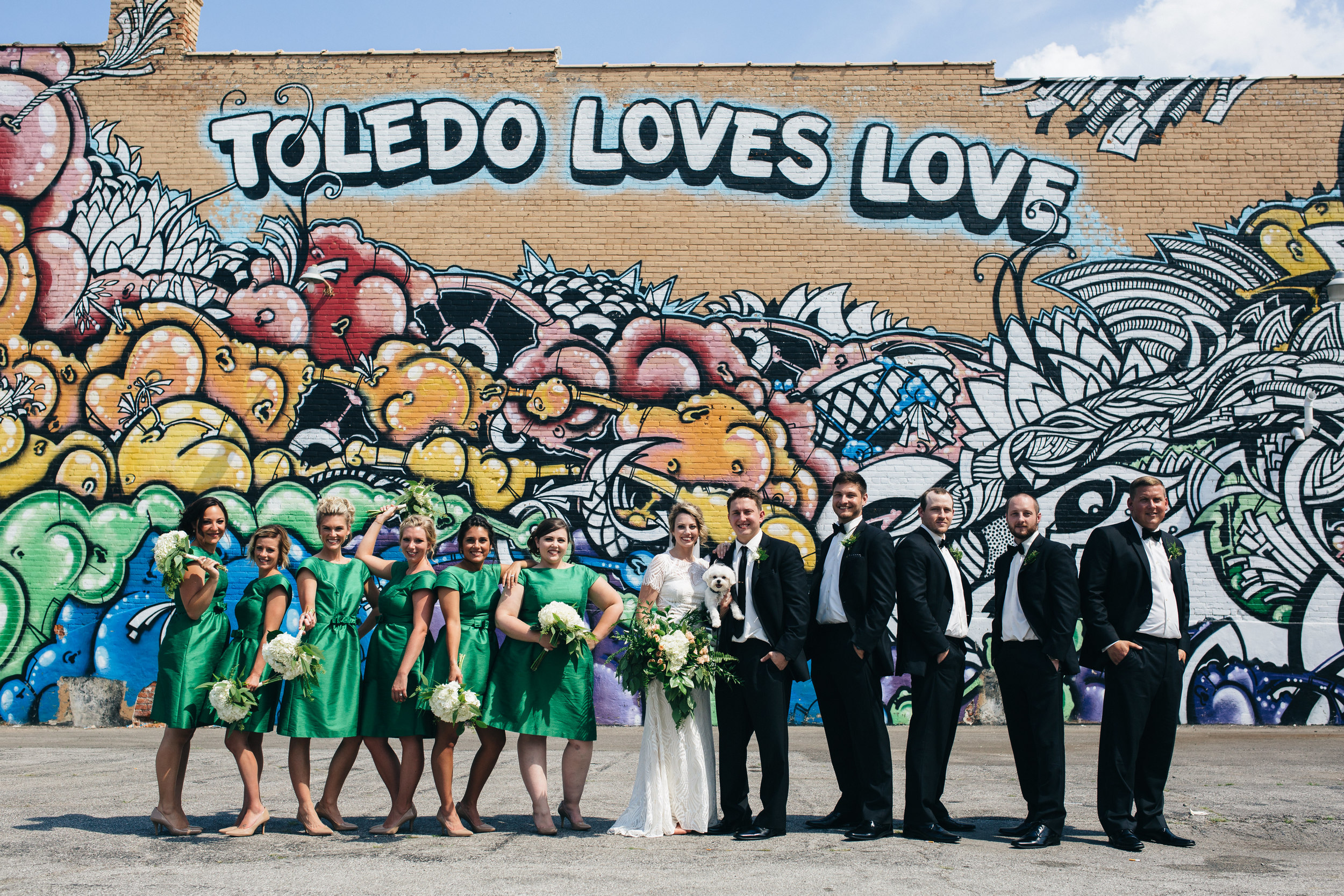 Bridal party photography at Toledo Loves Love wall in Downtown Toledo.