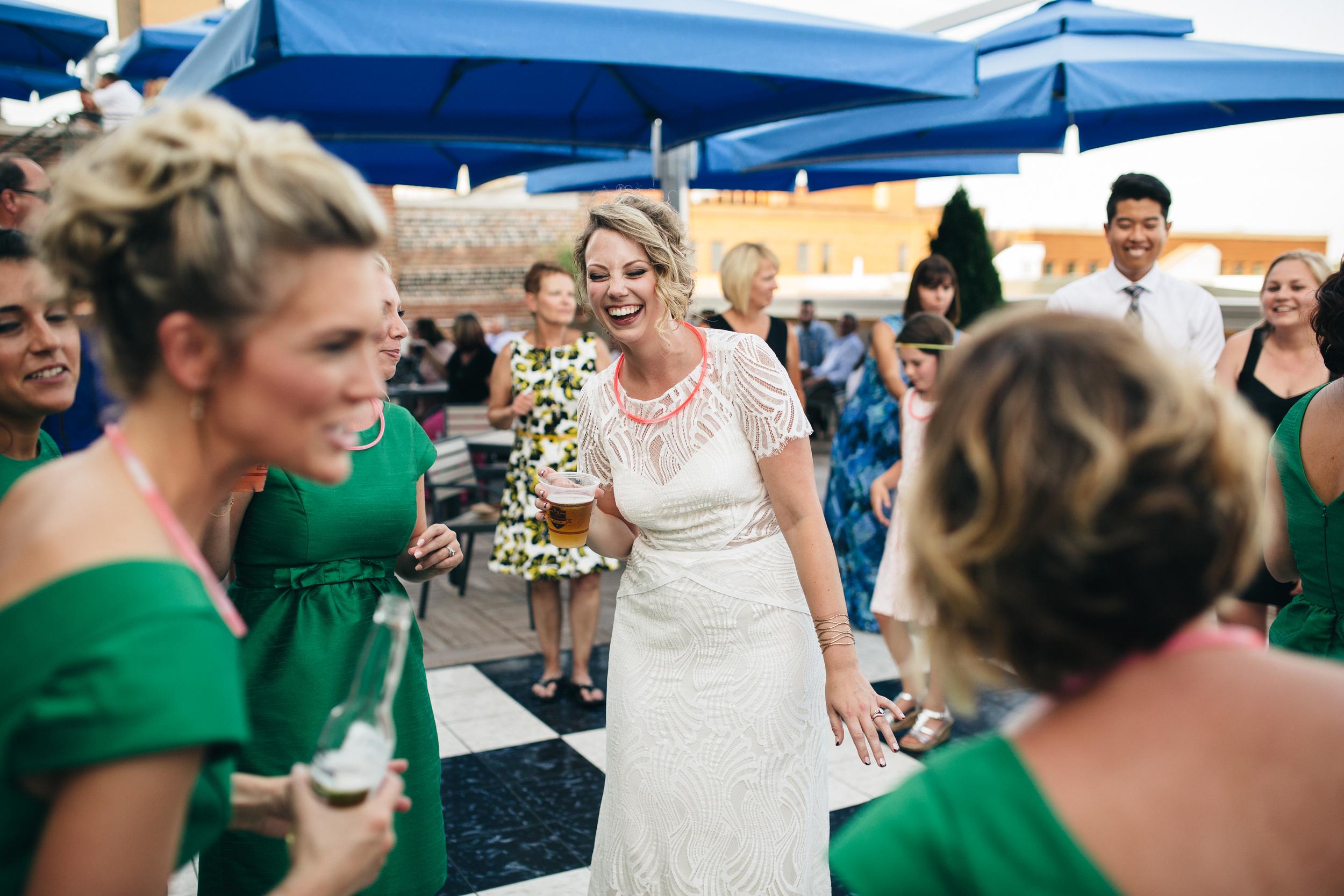 Bride dances at wedding reception.