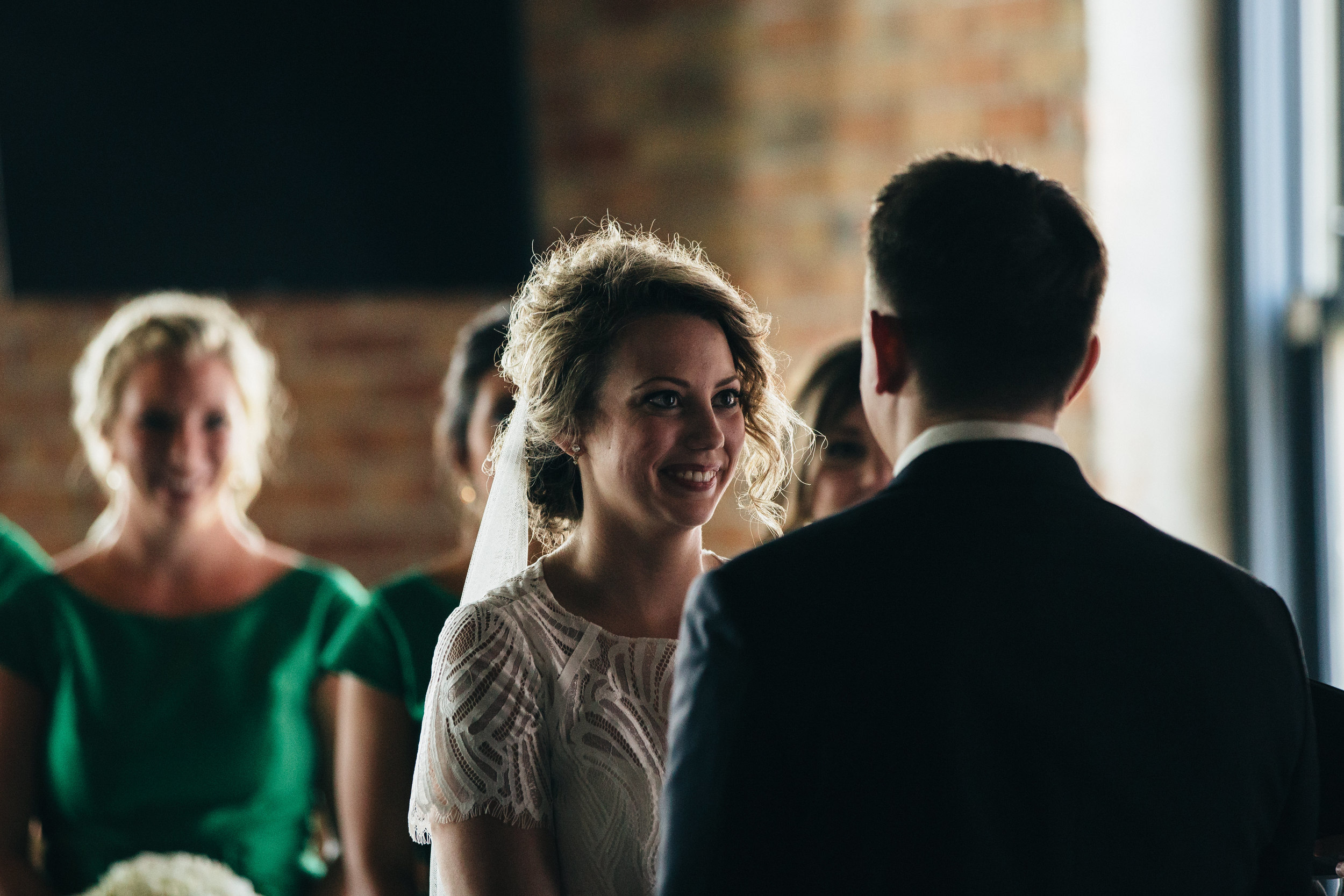 Bride during wedding ceremony at Hensville in Toledo.